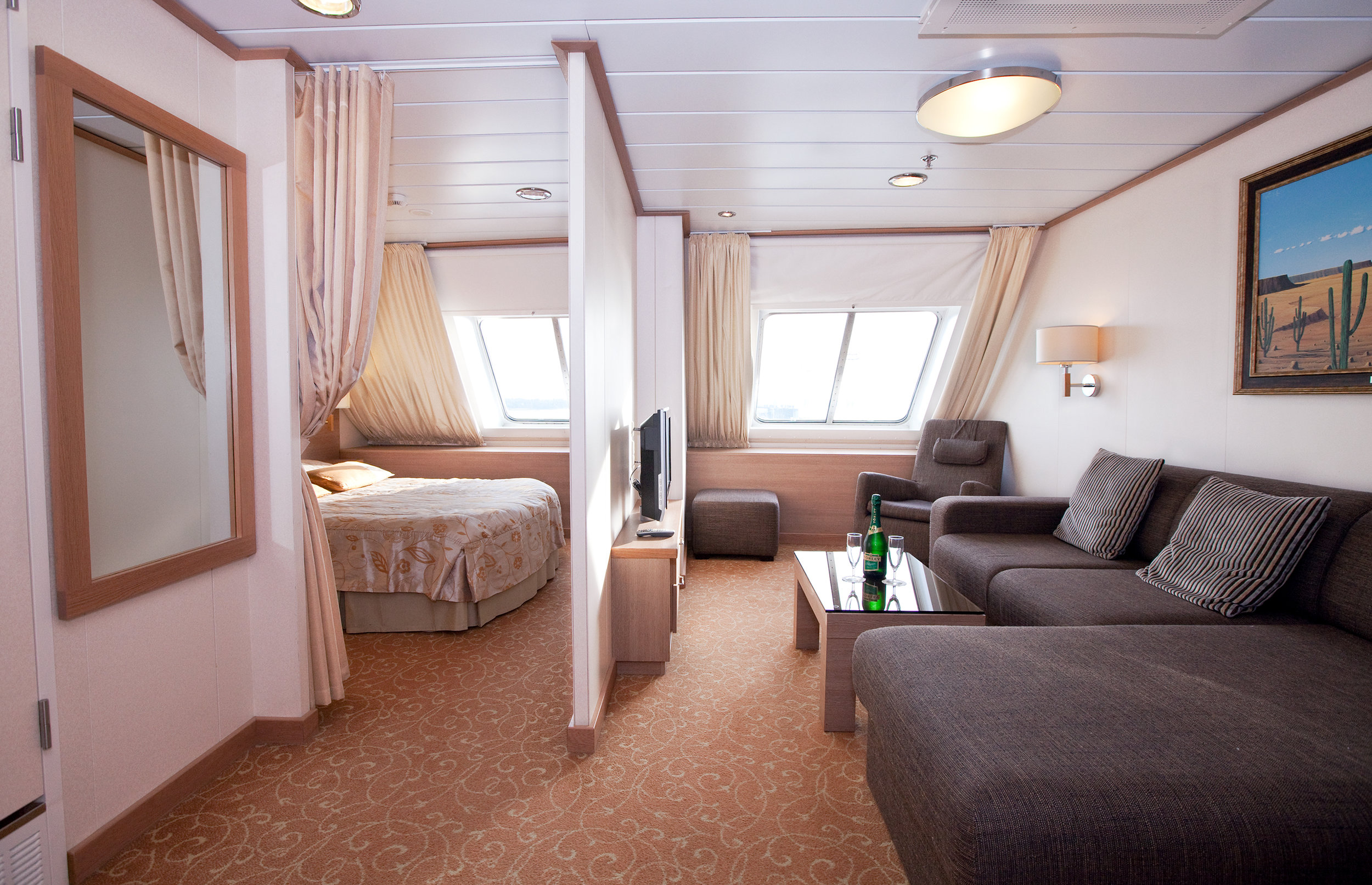 Suite –Class (top deck, double bed, a window)   120€/person for 2 passengers
