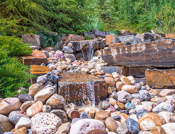 A custom stone waterfall feature in the Calgary and Banff area