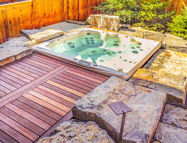 A sunken hot tub featuring a wooden deck in the Calgary and Banff area