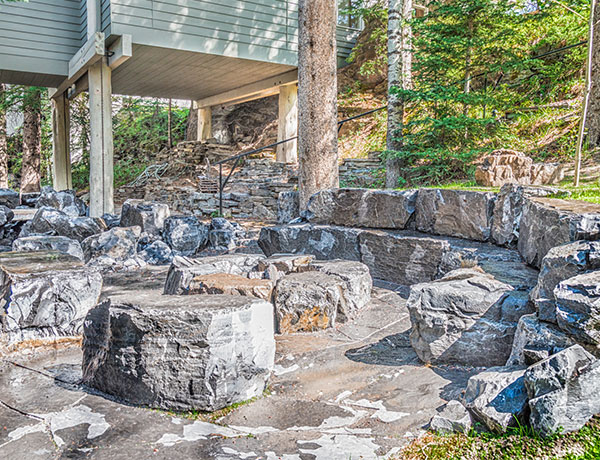 A backyard compete with rock features in the Calgary and Banff area