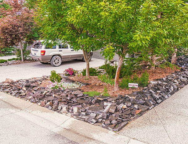 A front yard featuring custom outdoor lighting and stonework in the Calgary and Banff area