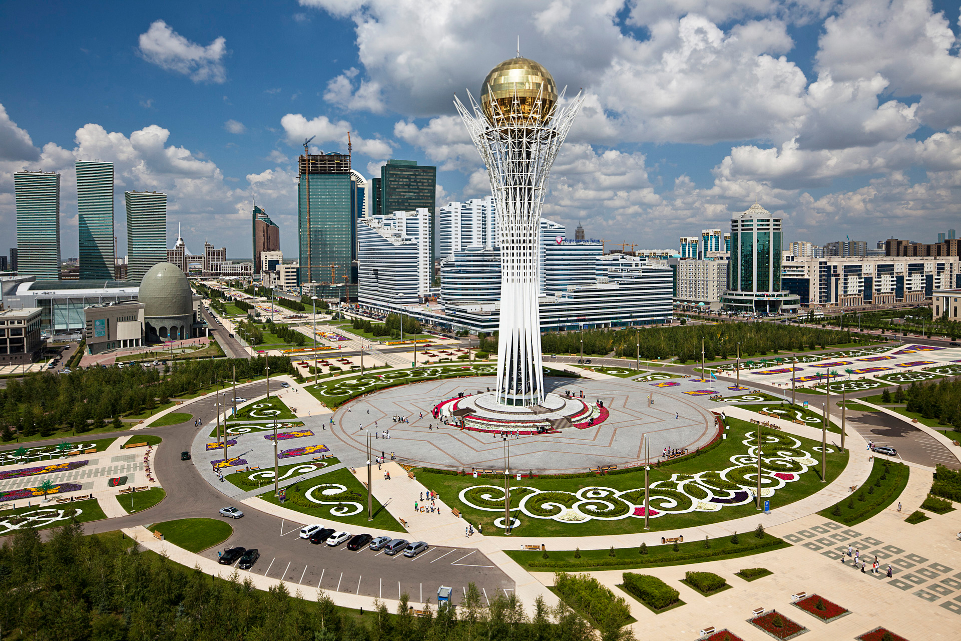 The Baiterek, towers over Astana's central promenade. Intended as a symbol of the new capital, the 318-foot monument evokes a giant tree with a golden egg in its branches. in the Kazakh myth of Samruk, a sacred bird lays a golden egg in the branches of a poplar tree each year.  Astana, Kazakhstan