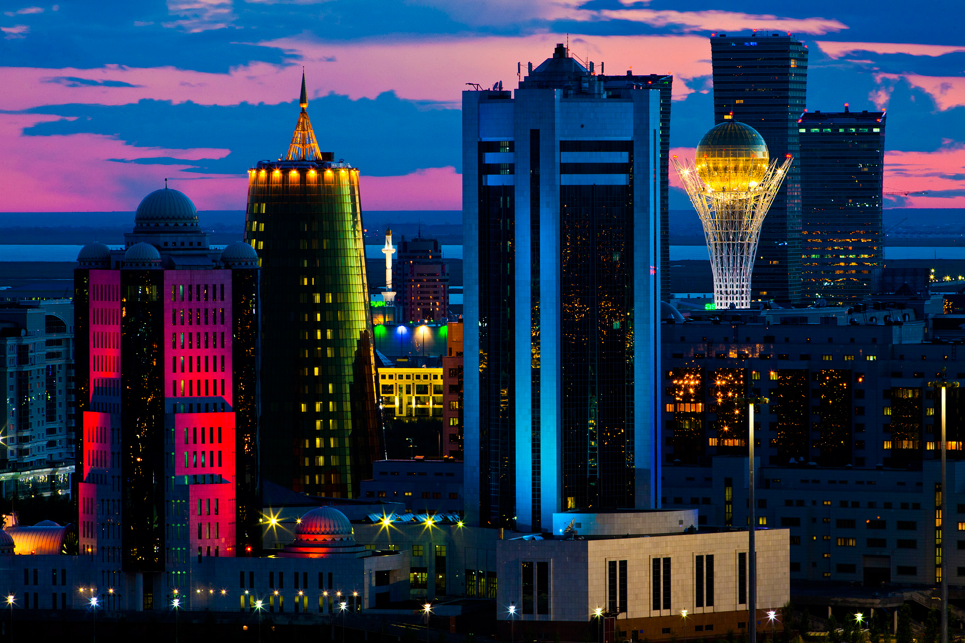 From the rooftop of the Right Bank's HighVill one is afforded a spectacular view of the Left Bank city center with the Parliament Buildings (red and blue), Samruk Kayzna (green), Baiterek, and other high-rises.  Astana, Kazakhstan
