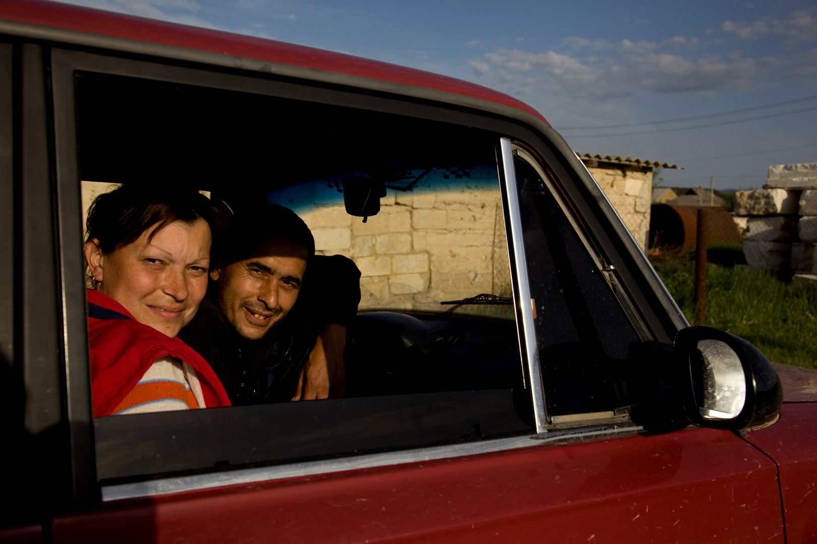 Behind this young Tatar couple are the new settlements in Sarysu, where the Tatar community has resorted to building temporary structures on state land in an attempt to reclaim ownership.  Sarysu, Crimea