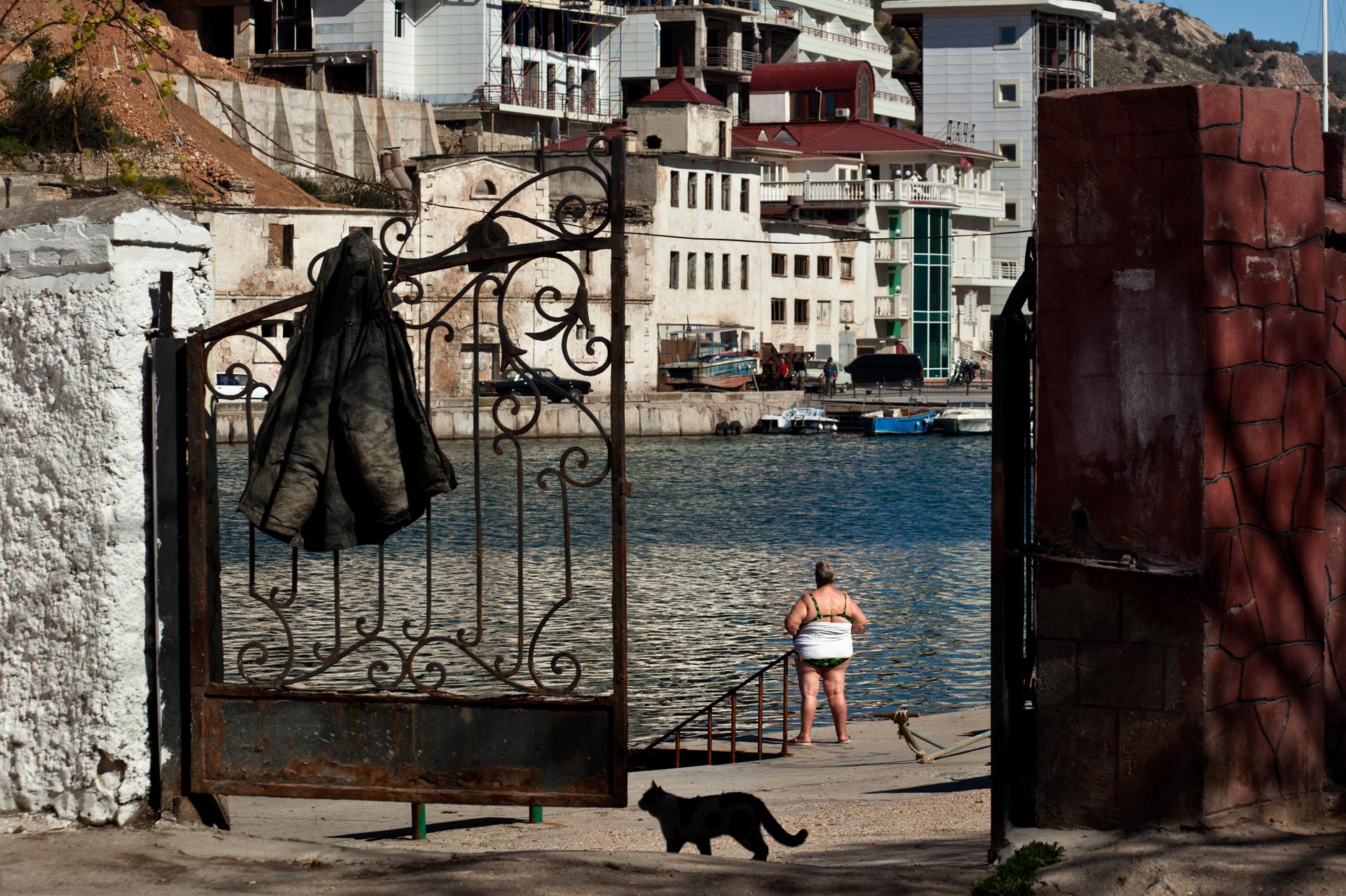 An inhabitant of Balaklava after taking a swim at the public concrete beach.  Balaklava, Crimea