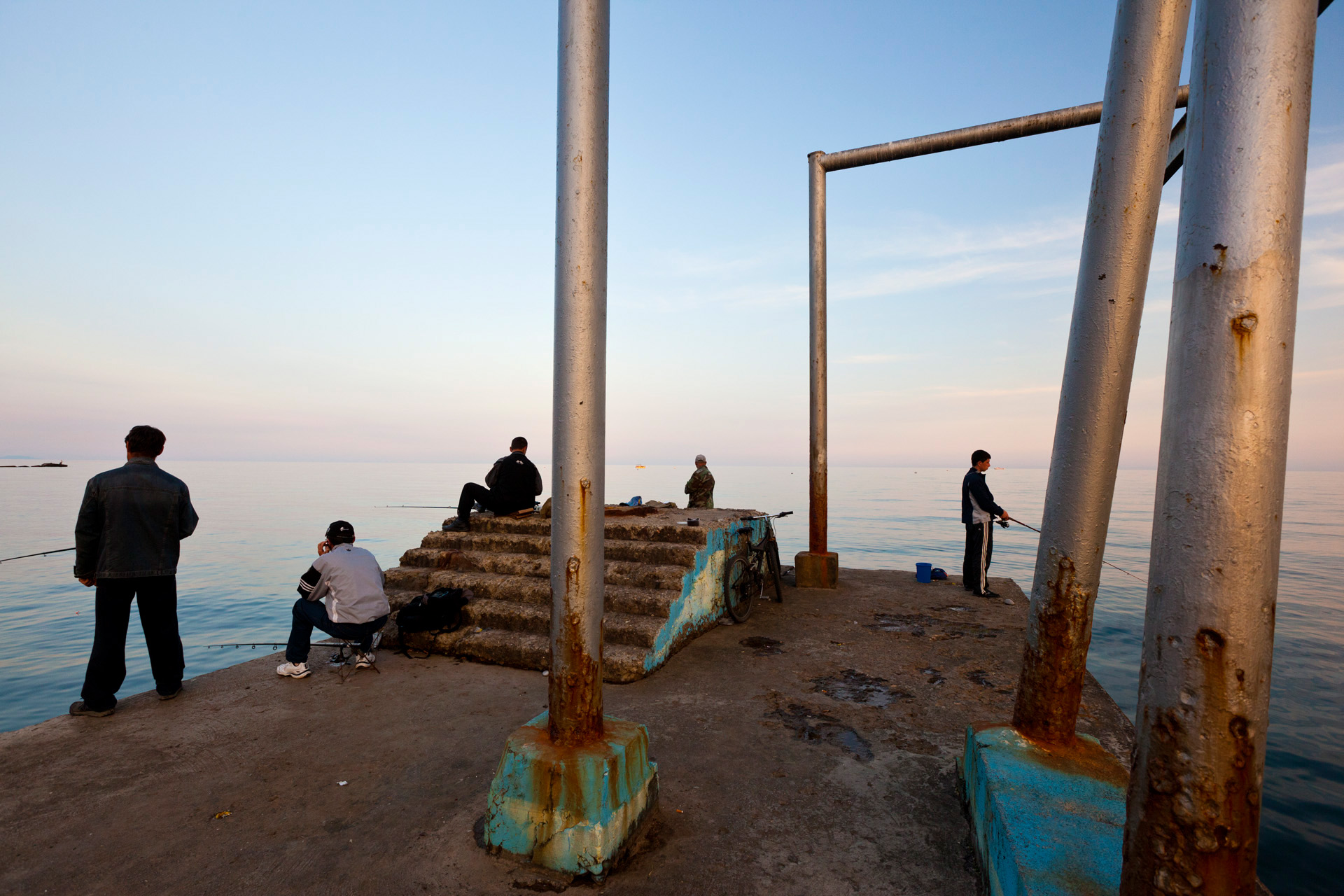 The lure of fishing leads to a jetty in Alushta. While tourism seeks a new identity on Crimea, many sites are still representative of its soviet past.  Alushta, Crimea