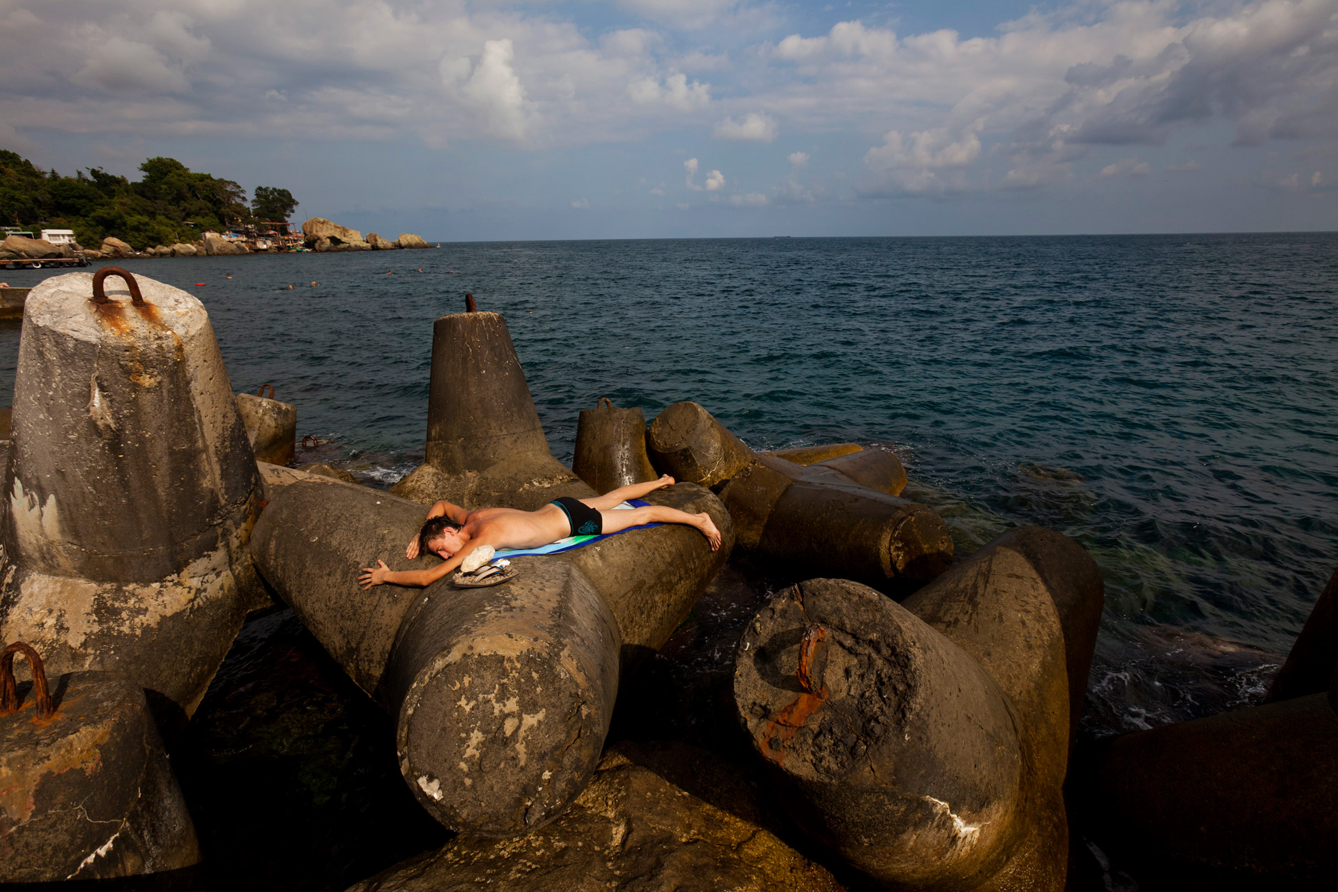 Just a short drive from Yalta lies Alupka, a popular resort town. Tourists from the former Soviet countries do not seem to mind the large concrete and steel breakers scattered across the coastline and frequently use them as sunbathing spots away from the crowds.  Alupka, Crimea
