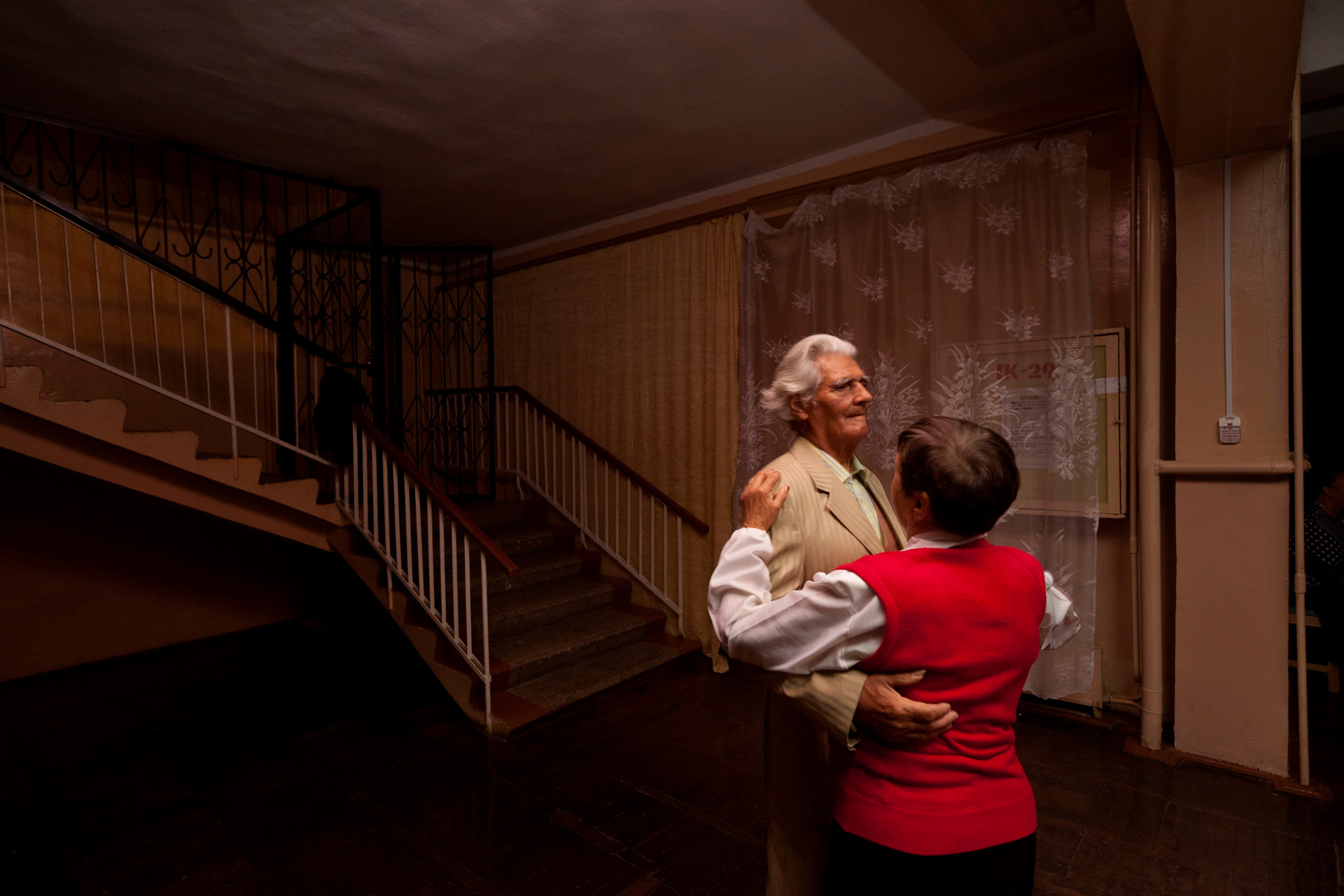 The dances of old age may be slower, but no less sweet, for a couple at the Veterans Sanatorium in Alushta.  Alushta, Crimea