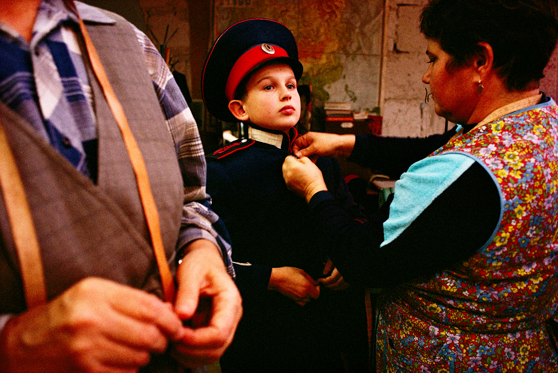 Following a proud tradition, a young soldier-to-be is fitted for his uniform at the Royal Cossack Cadet Academy. Established in 1883, closed by Stalin in 1933, the academy reopened its doors in 1991.  Novocherkassk, Russia