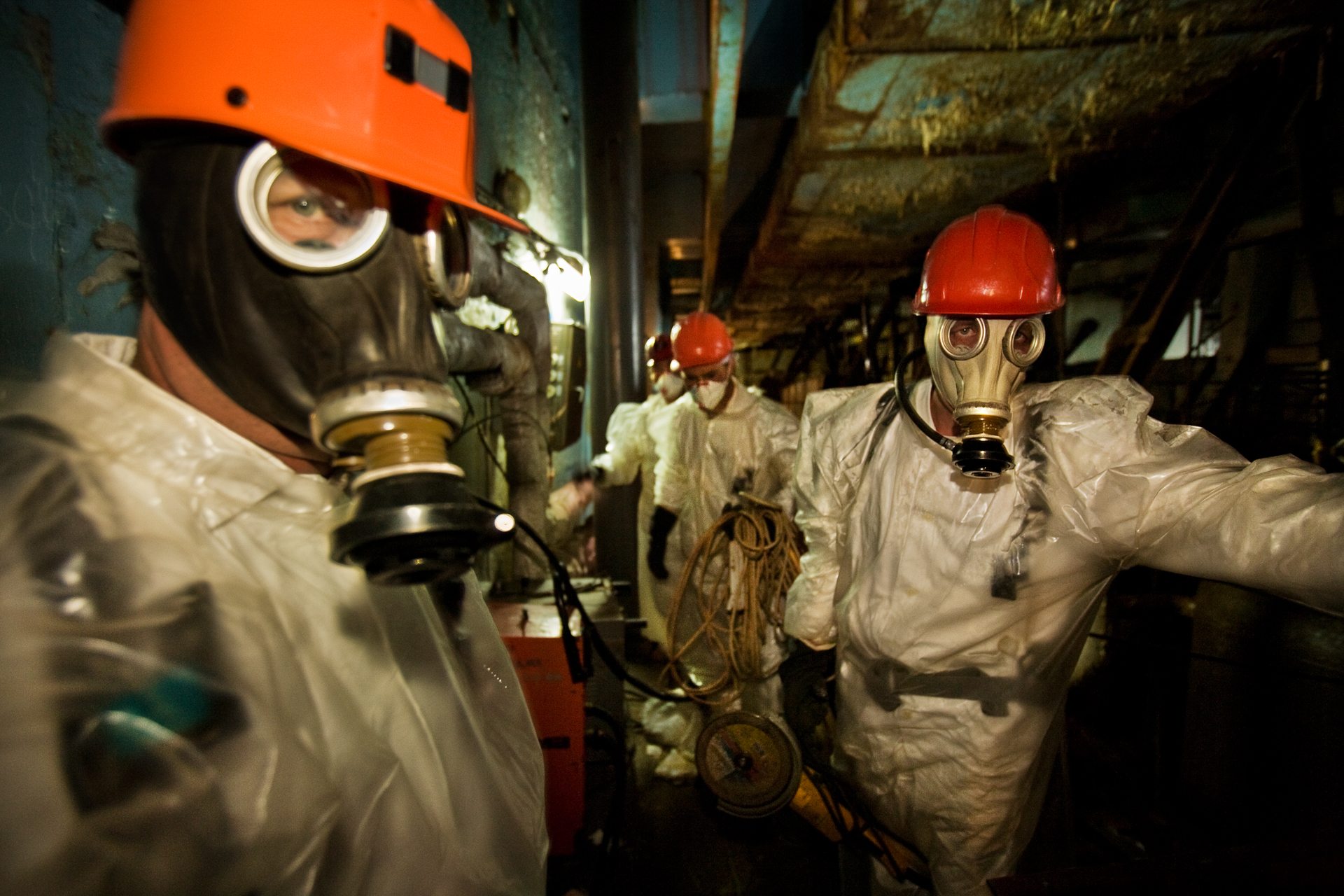 Chernobyl plant workers wearing plastic suits and respirators enter the so-called diarator stack, where radiation is so high that workers can risk shifts no longer than 15 minutes per day.  Chernobyl Nuclear Power Plant, Ukraine