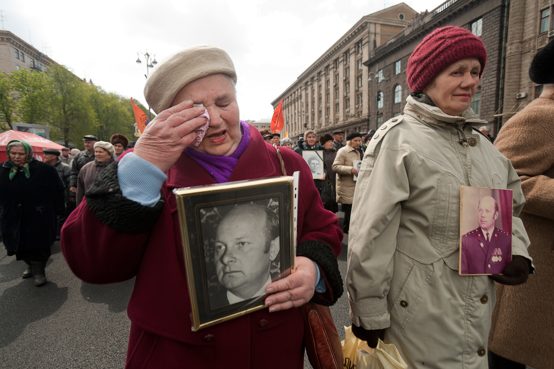 A group of women known as Chernobyl Widows carry photographs of their deceased loved ones during a 5,000 strong demonstration in Kiev on the anniversary of the Chernobyl accident.  Kiev, Ukraine