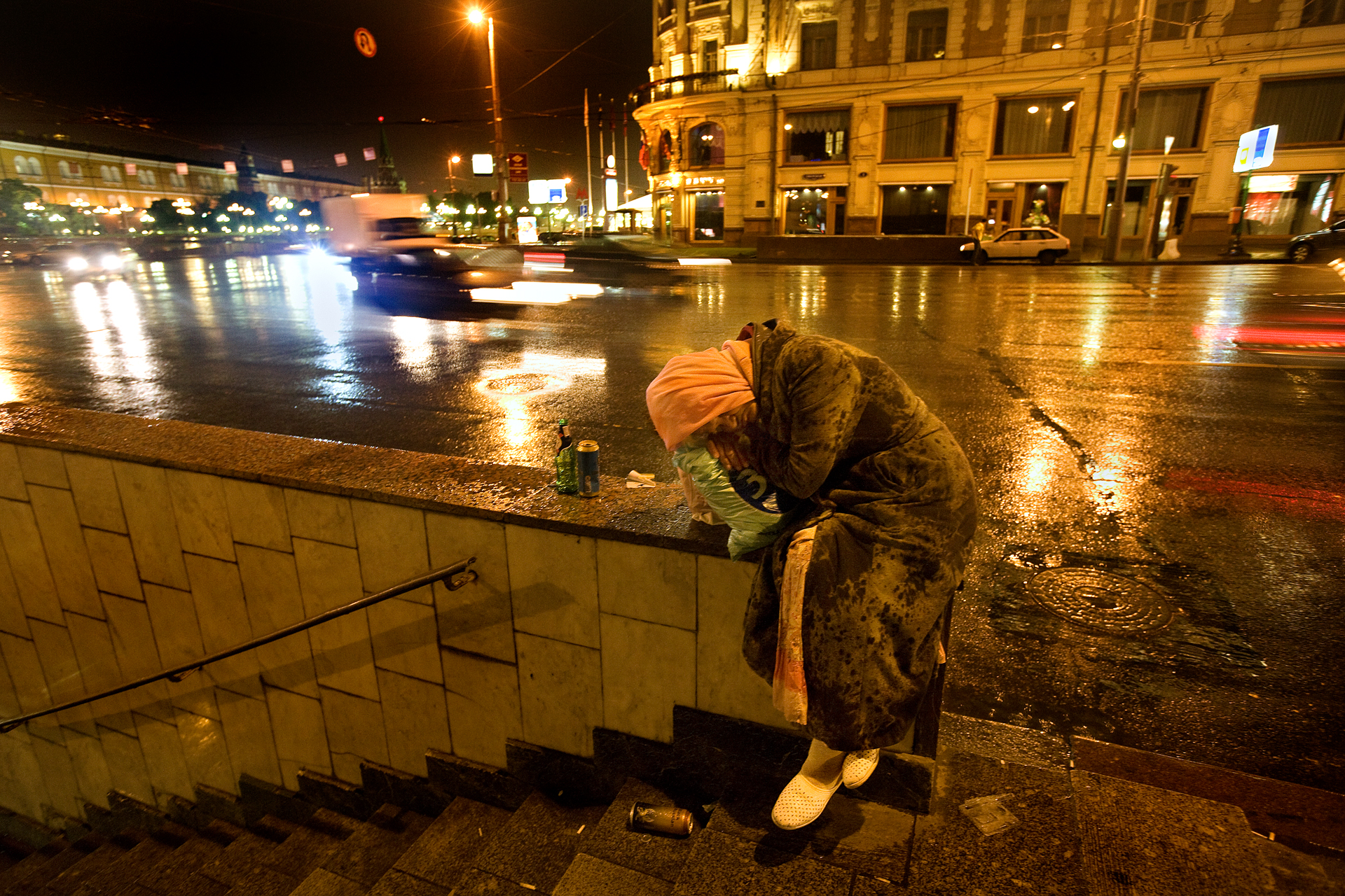 2:50 AM - A homeless woman sleeps on Tverskaya Street on a rainy Moscow night.