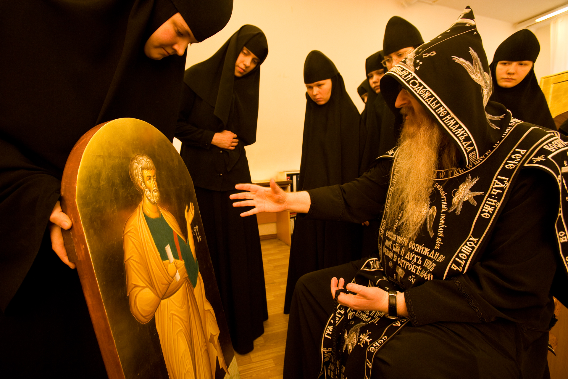 Judgment day arrives at Novo-Tikhvinsky cloister when Father Abraham sits down to critique icons painted by resident nuns.  Yekaterinburg, Russia