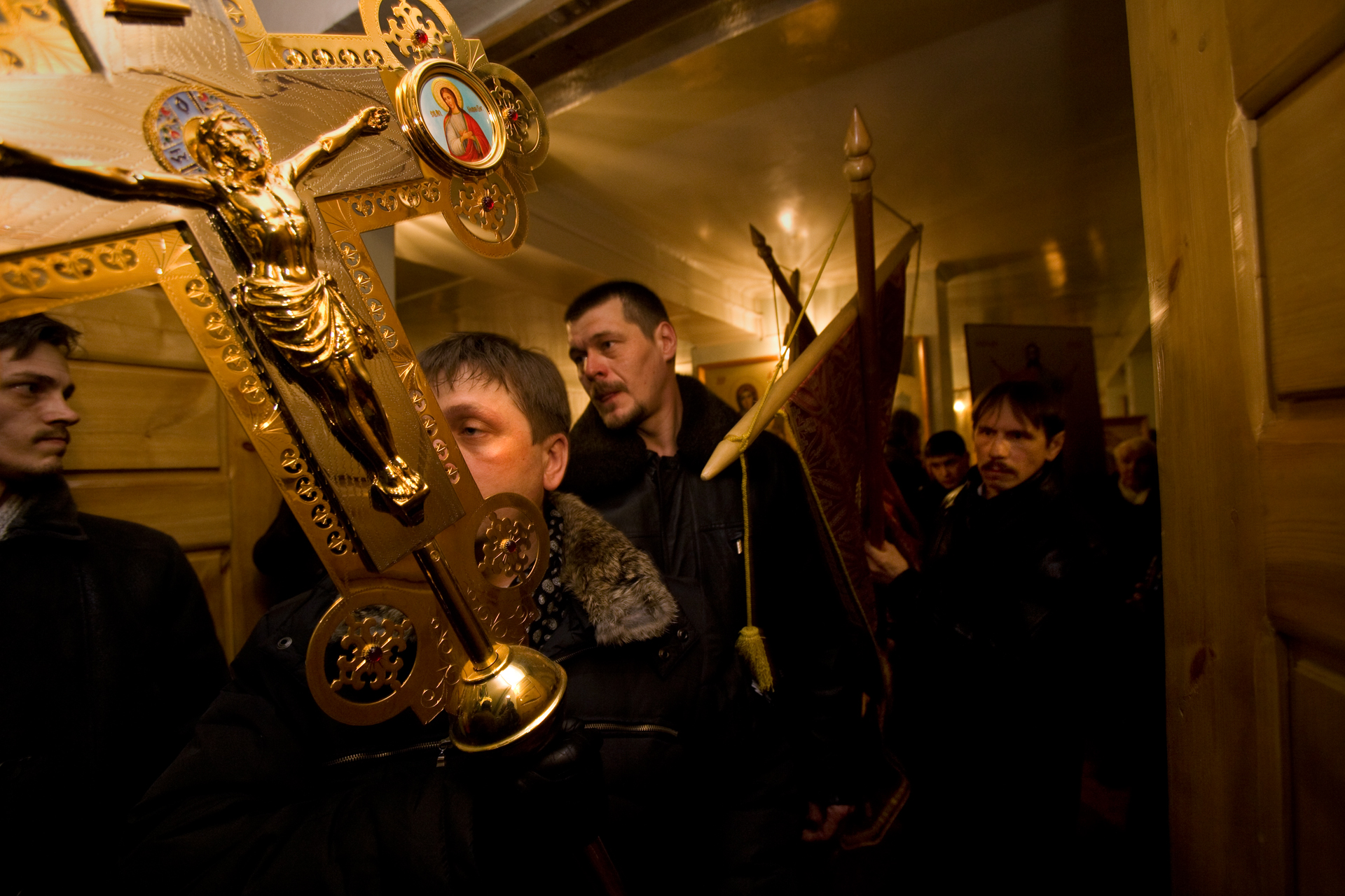 The weight of ritual intensifies on Easter Sunday as parishioners collect banners and icons for a procession before midnight Mass.  Vorkuta, Russia