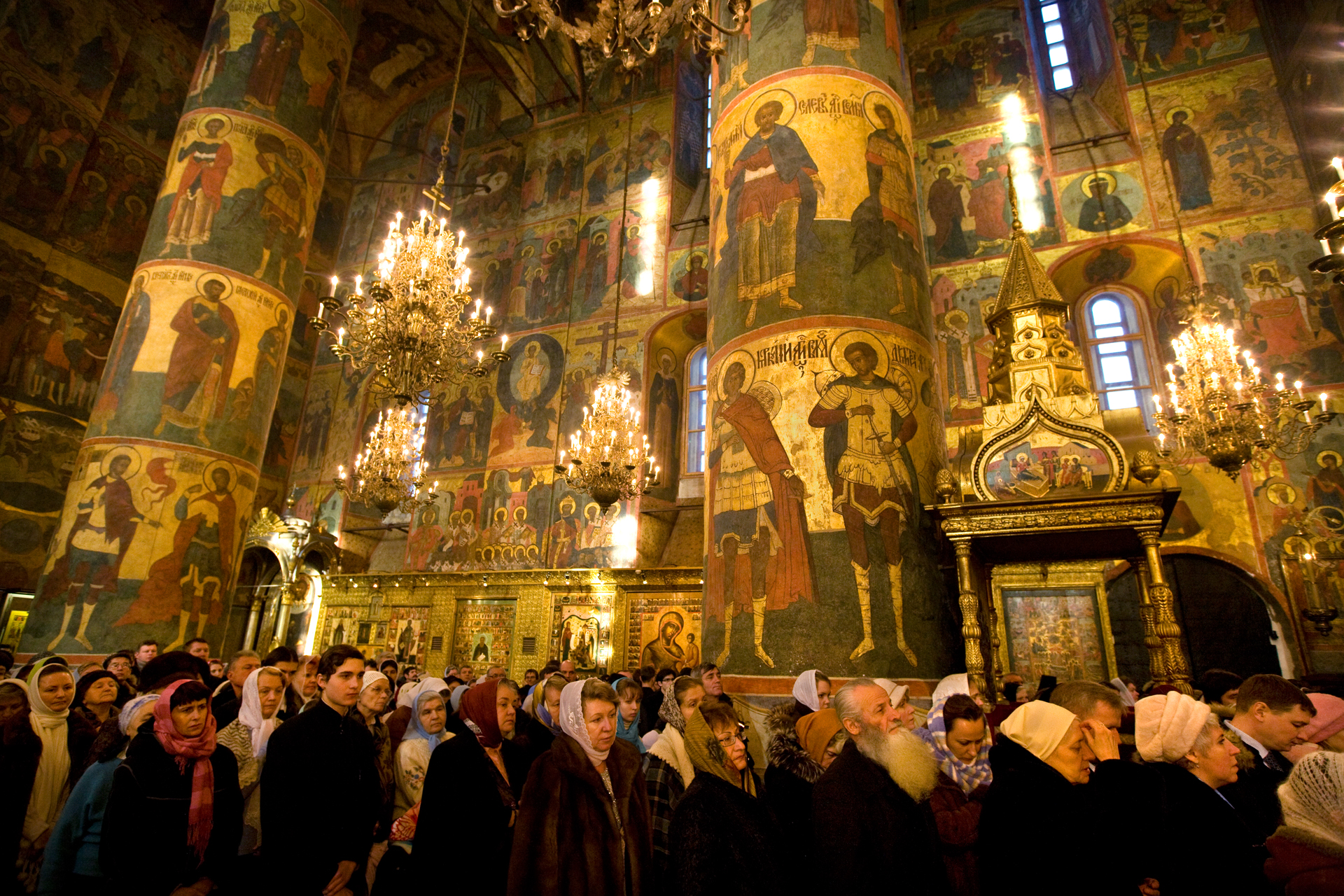 Resplendent icons of saints oversee Mass at the restored 15th-century Assumption Cathedral in the Kremlin.  Moscow, Russia