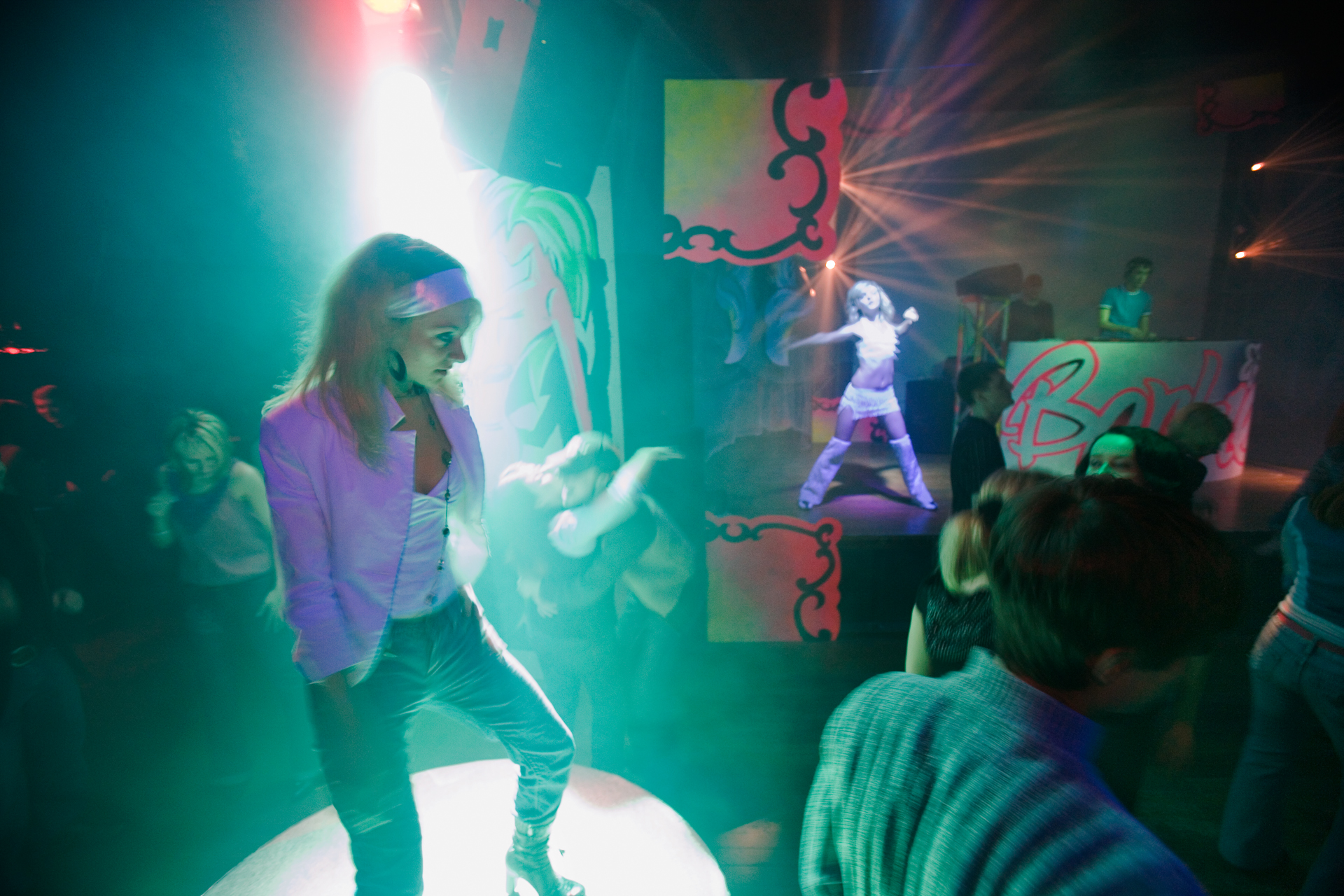 """The swagger of youth and new money keep the dance floor busy until dawn at the """"Champions' Territory"""" nightclub.  Khanty-Mansiysk, Russia"""