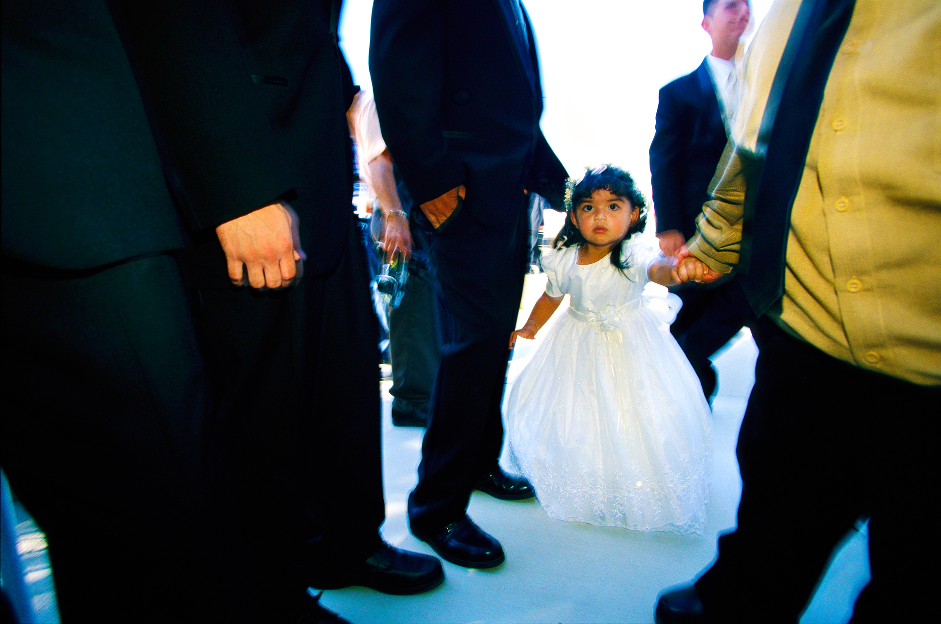 This little girl is headed for her aunt's quinceañera, a Hispanic rite of passage for Latina girls turning 15.  Niland