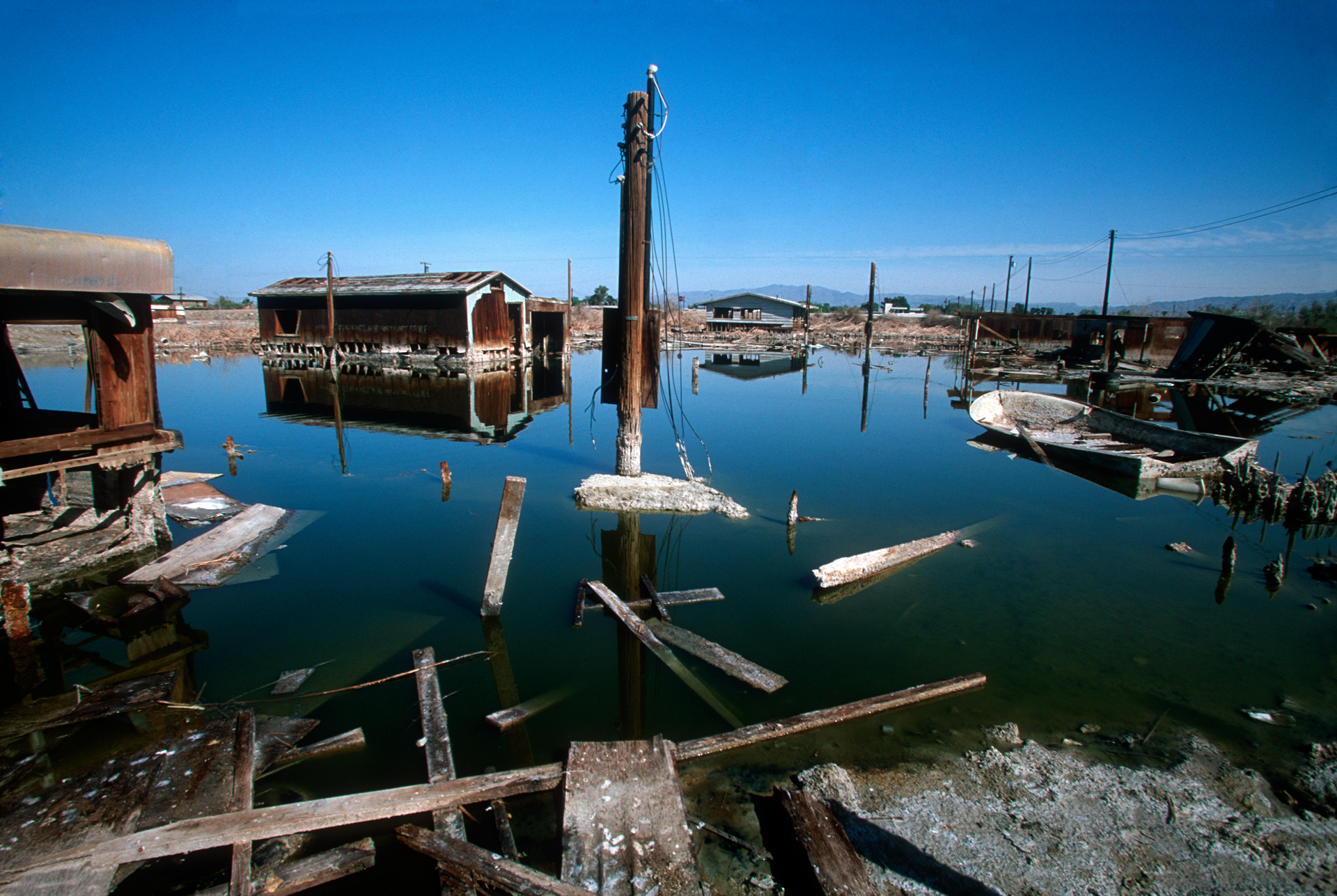 The fluctuation in sea level has flooded abandoned homes, leaving them to rot in the salt encrusted water.  Bombay Beach