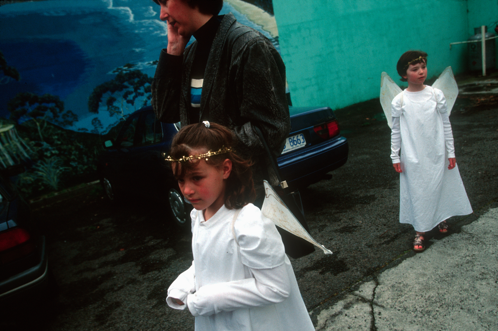 Two young girls dressed as angels are escorted by their mother to the Hobart annual Christmas Parade that kicks off the Christmas season in Tasmania.  Hobart