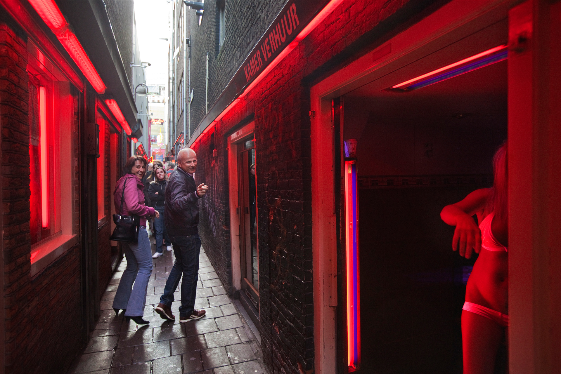 Located in the oldest section of Amsterdam, the De Wallen red-light district is best known for it's rows of neon-lit windows displaying prostitutes offering sexual services.