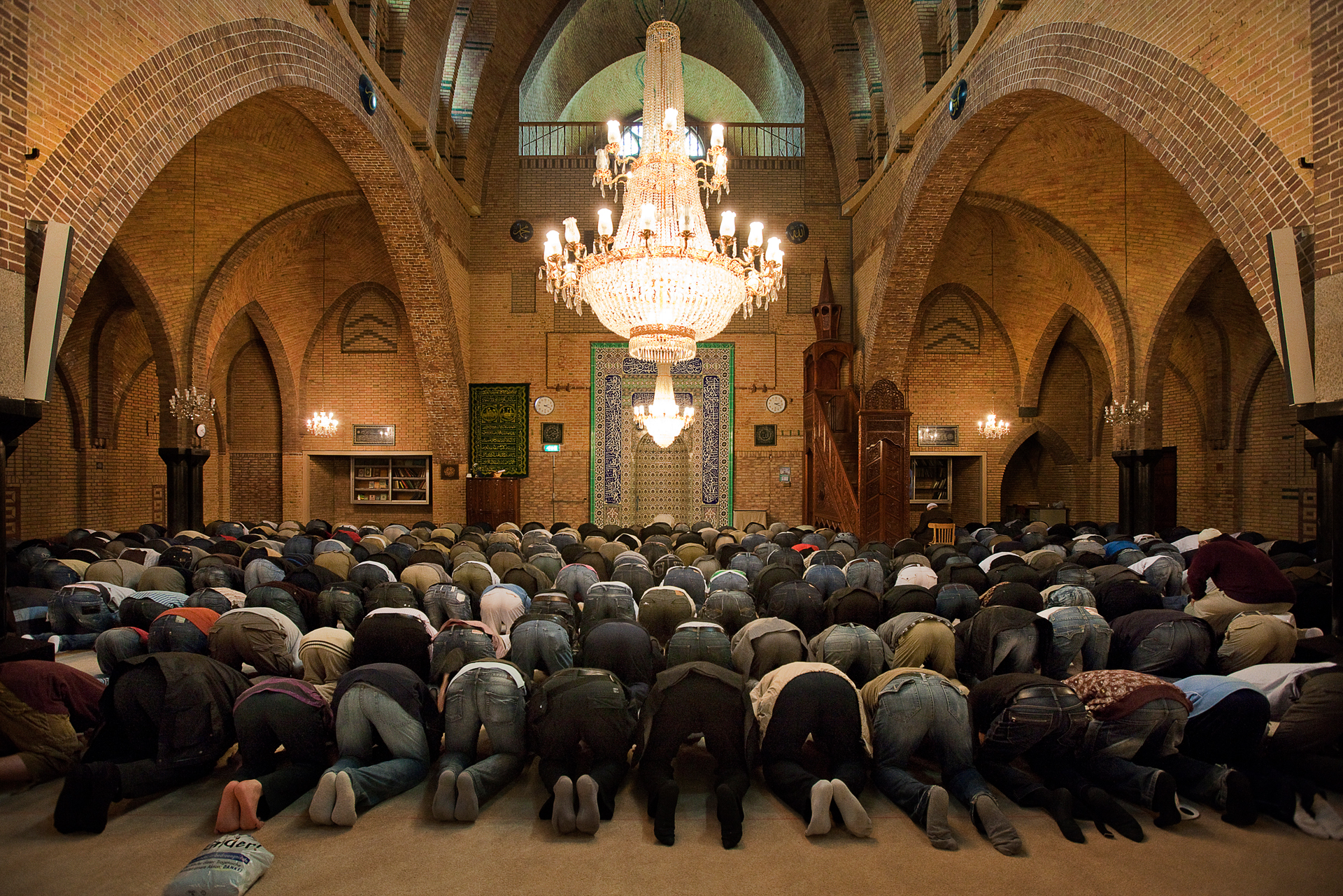 Men pray at the Turkish Fatih mosque on Rozengracht in Amsterdam.