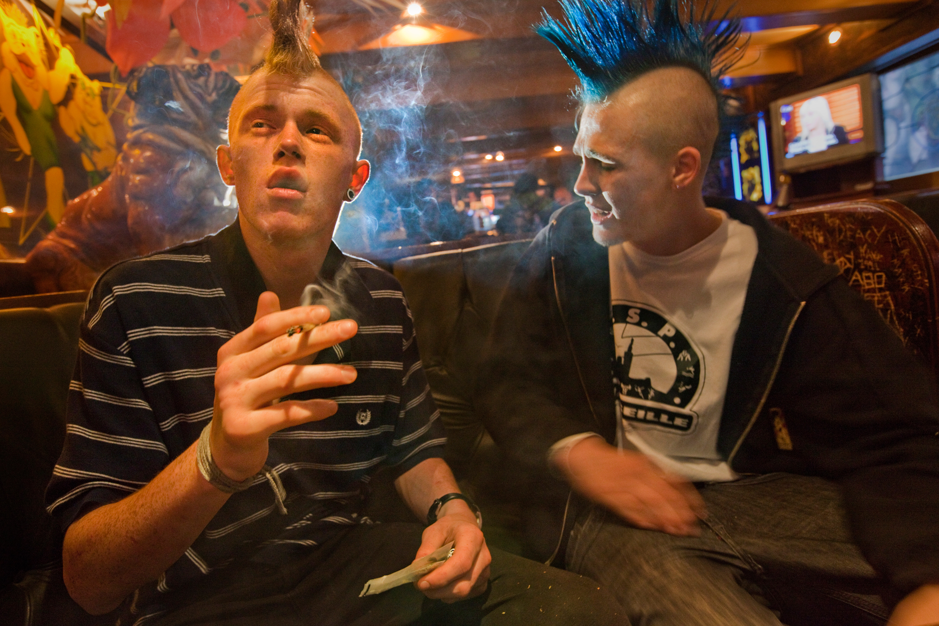 Sporting Mohawks, two customers enjoy hash at The Bulldog, a famous cannabis-selling coffee shop in Amsterdam's Red Light District.