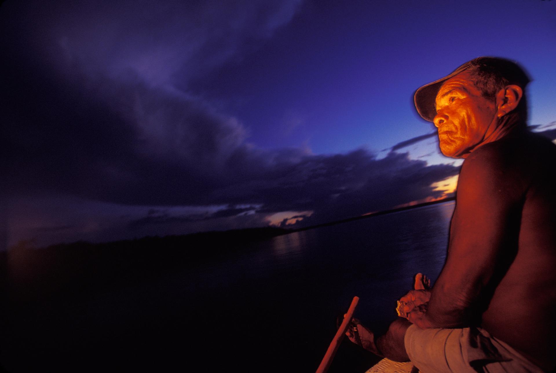 Watching the moonrise from a boat on the Rio Canuma near Niteroi in Kwata-Laranjal.  Niteroi, Brazil