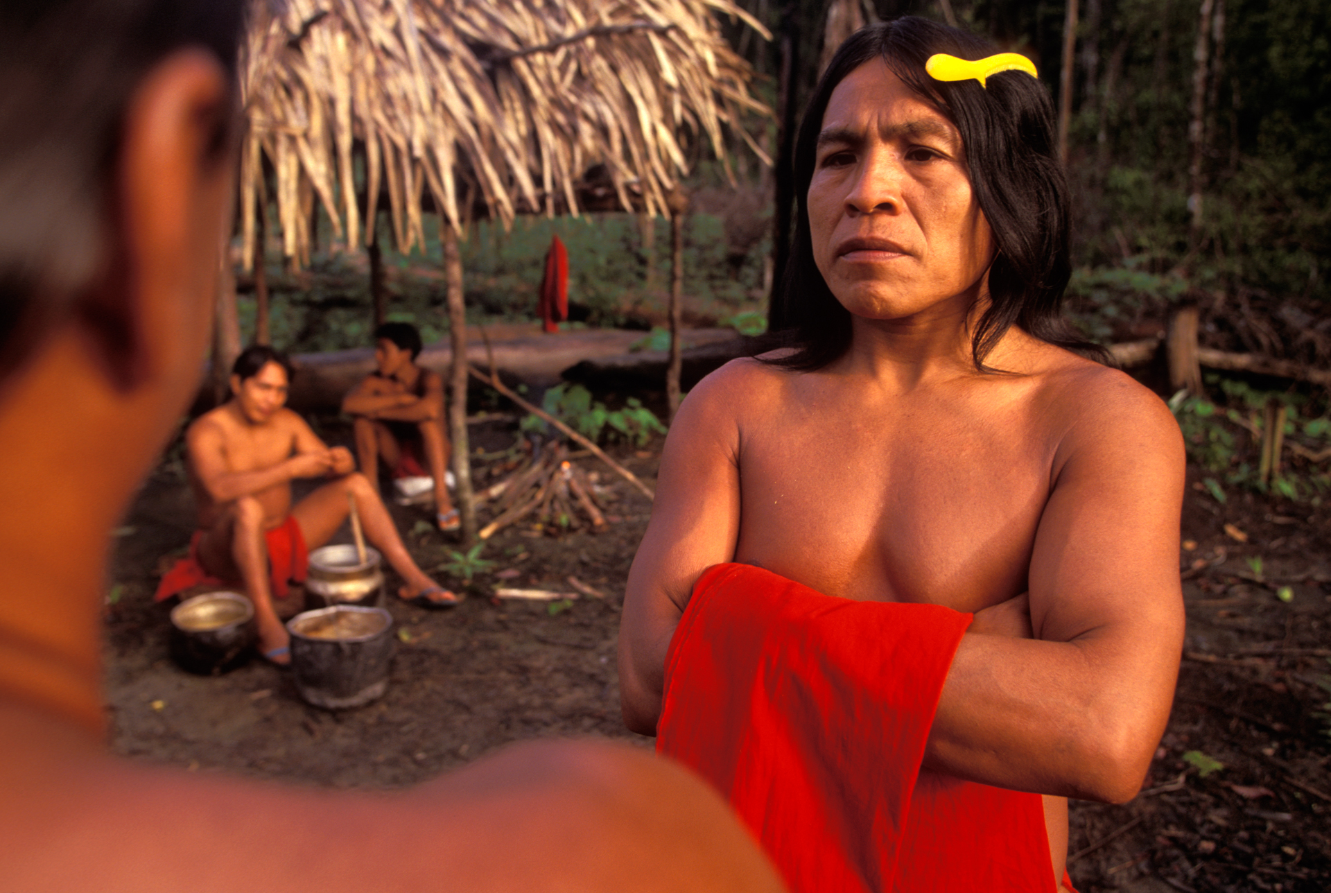 Kumare, chief of the Waiapi, listens attentively. A yellow plastic comb and the red loincloth are some of the visible influences from western culture.  Ari, Brazil