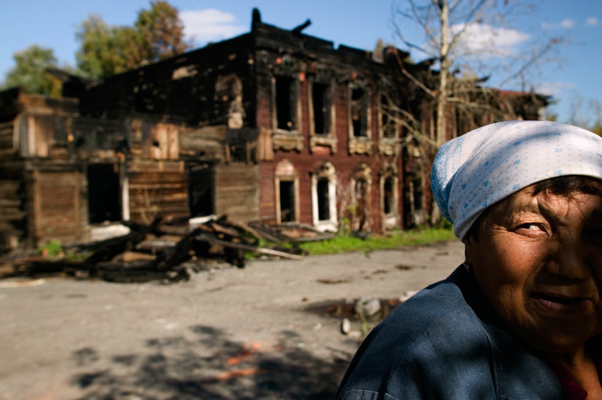 In Tobolsk, one of Bering's primary recruiting stops, villagers forage through the remains of a burned-out building.  Tobolsk, Russia