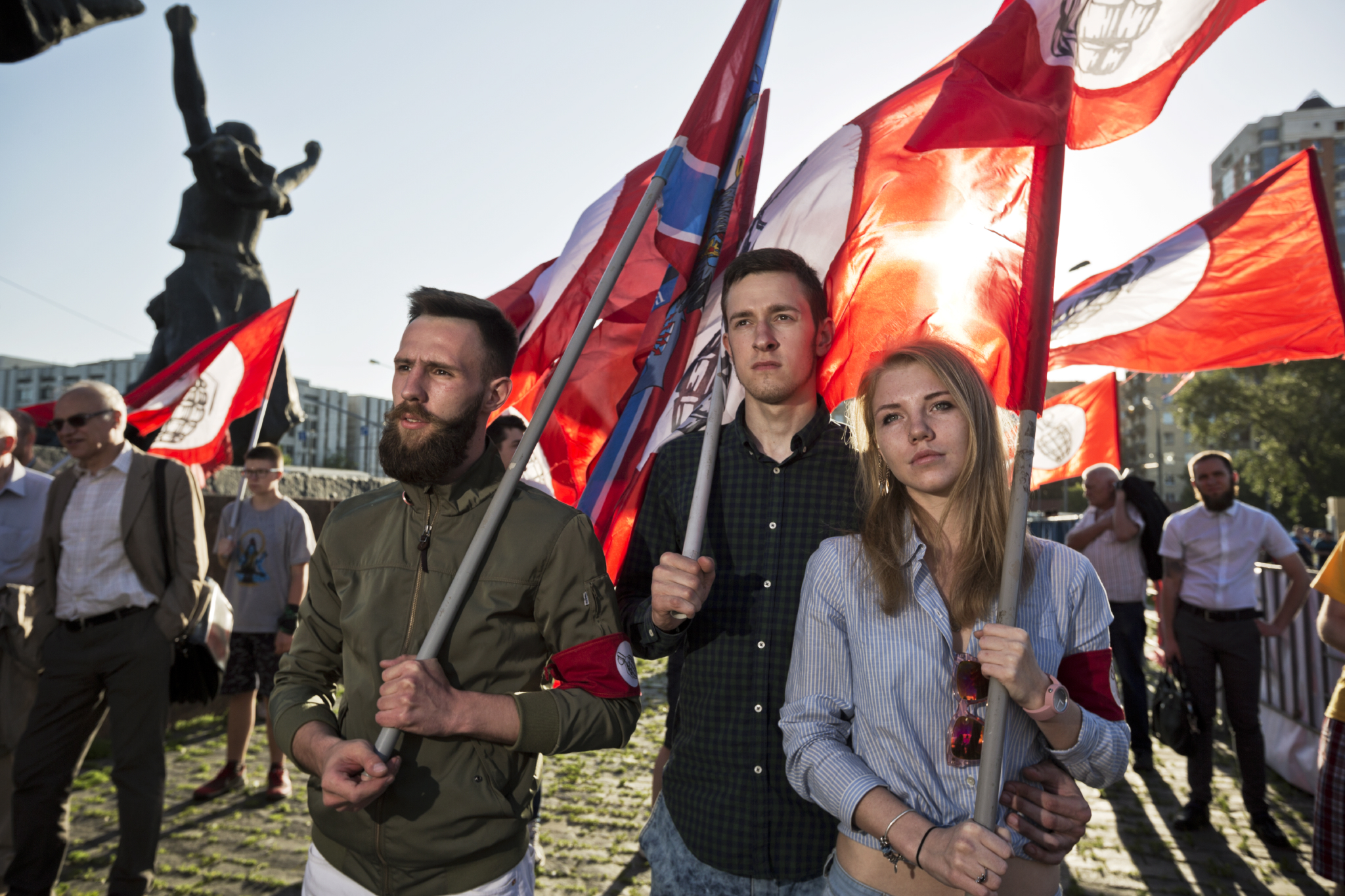 Kostya , 21, and his girlfriend Anastasiya, 20, supporters of the Other Russia, an opposition party, rally in Moscow displaying flags and armbands with their symbol, a grenade. The Other Russia was formed by members of a banned ultranationalist political party in 2010, but it is not recognized by Putin's government.  Moscow, Russia
