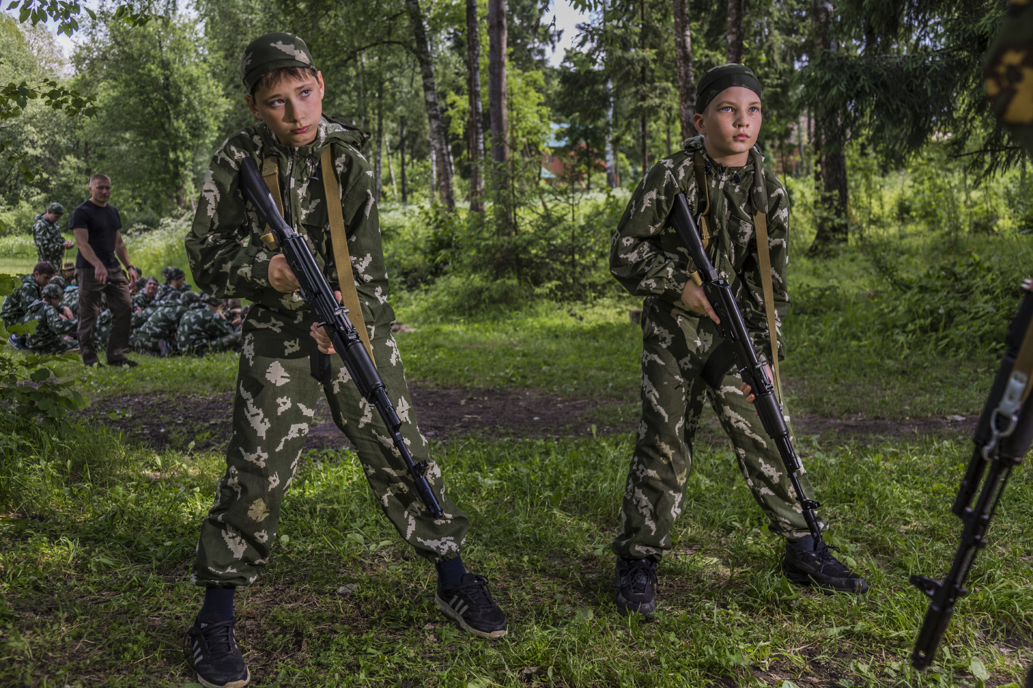 At a sports and military camp, paratroopers teach children as young as 10 years old how to handle weapons. Putin has tried to restore Russian pride in the country's military by defeating rebels in Chechnya, seizing Crimea, invading Ukraine, and intervening in Syria.  Klin, Russia