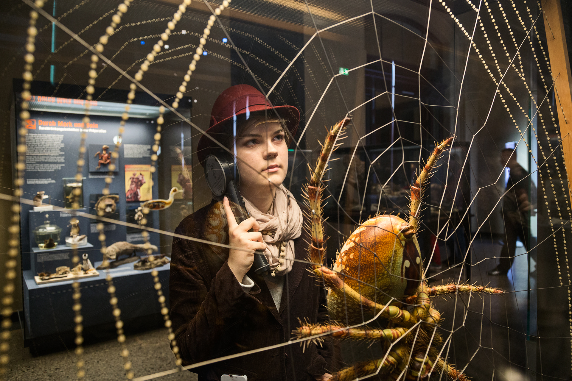 A visitor to the museum looks at an enlarged model of a spider.  Berlin, Germany.