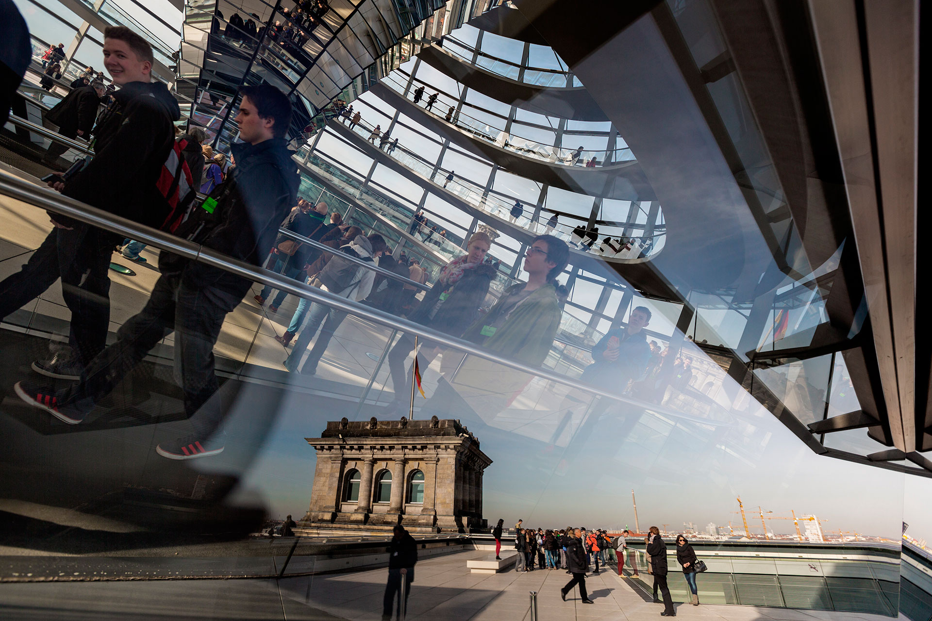 In the 1990s, British architect Norman Foster restored Germany's 1984 parliament building, the Reichstag, damaged in World War II. He added a central glass dome to symbolize transparency.  Berlin, Germany.