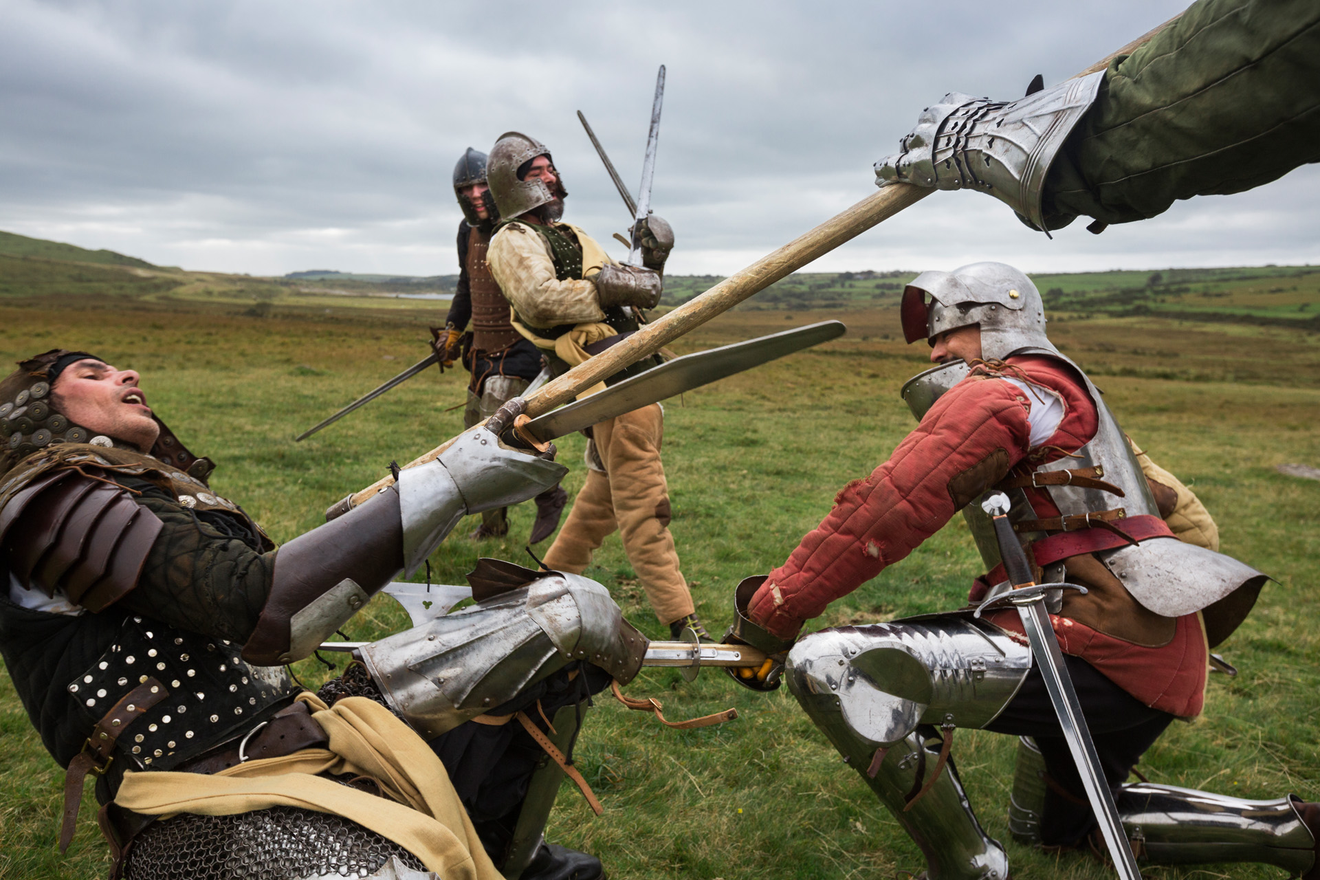 Members of the Cornwall based group Kernow Levy re-enact a battle: No battle was ever lost by King Arthur until he and his son Mordred faced one another in Slaughterbridge along the Camel River. Mordred was killed in the battle, while heavily wounded Arthur was brought to Avalon, land of the fairies, on a boat.  Tintagel, England.