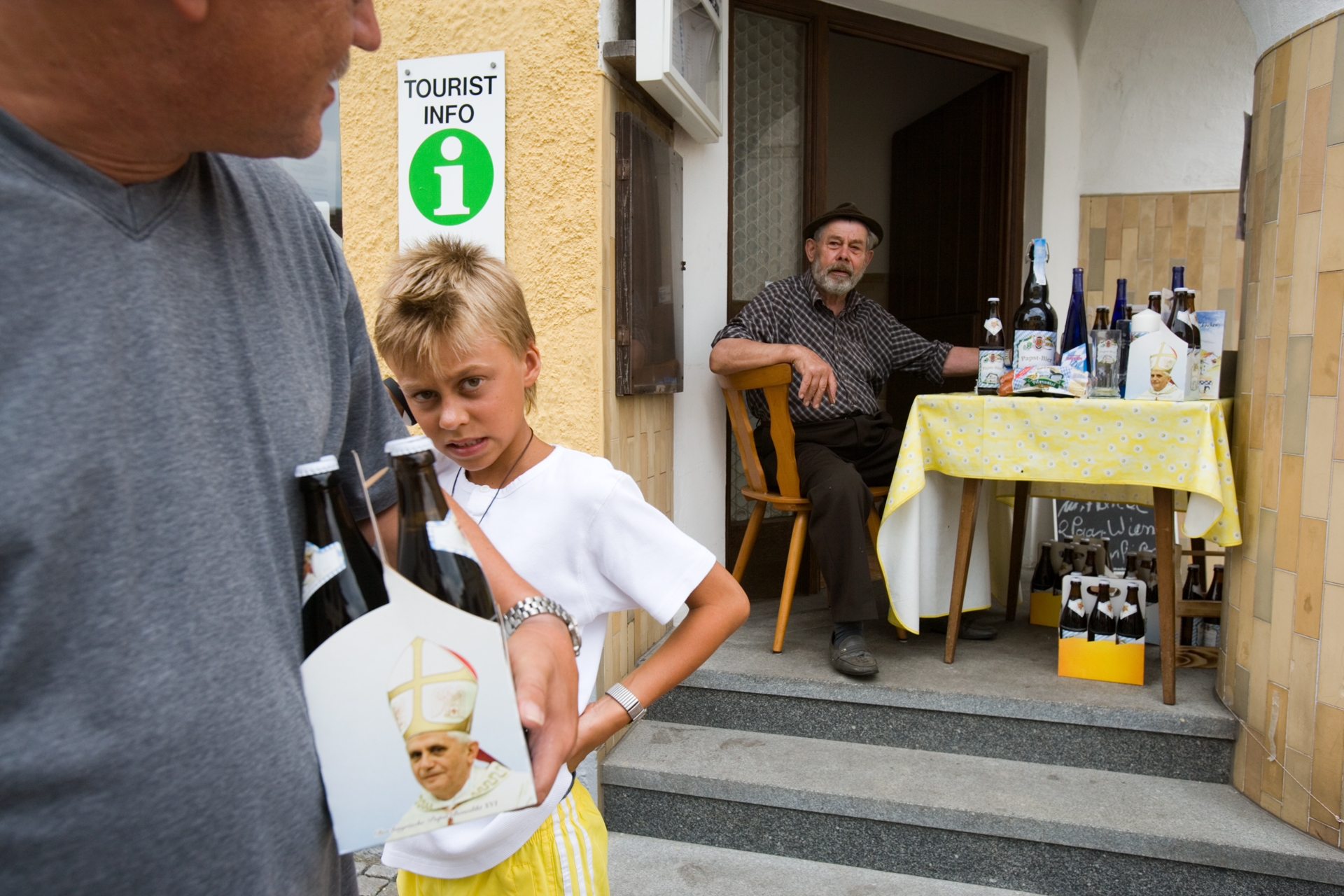 No one in Marktl has been quicker to spot the Pope's commercial potential than the brewers of Pope Beer, which is sold in grocery stores, gas stations, and this makeshift stand.  Marktl, Germany