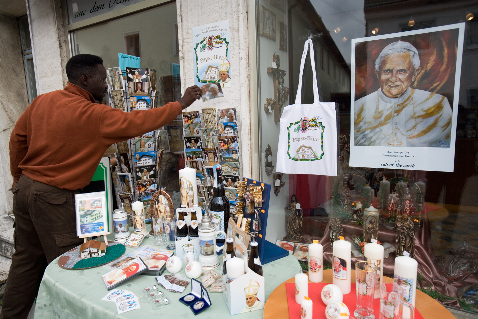 Visitors can buy Pope postcards, Pope posters, Pope candles, Pope key rings, Pope pastries, Pope candy, Holy water with the Pope's image, Pope beer, Pope wine, Pope T-shirts, and more.  Marktl, Germany