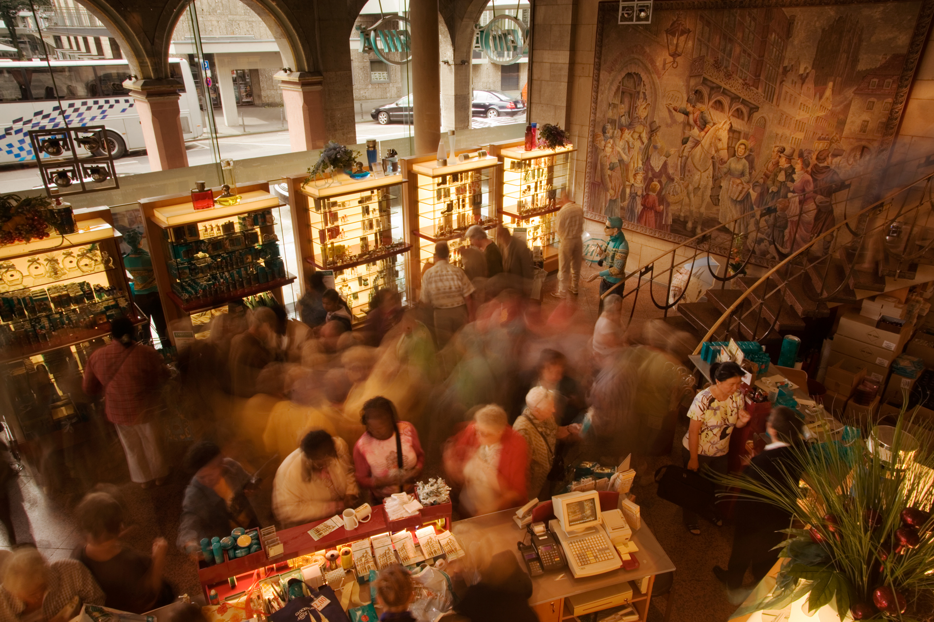 Like clouds of fragrance, tourists drift through the 4711 perfume store in Cologne, which sells the world's oldest and most continuously produced fragrance.  Cologne, Germany