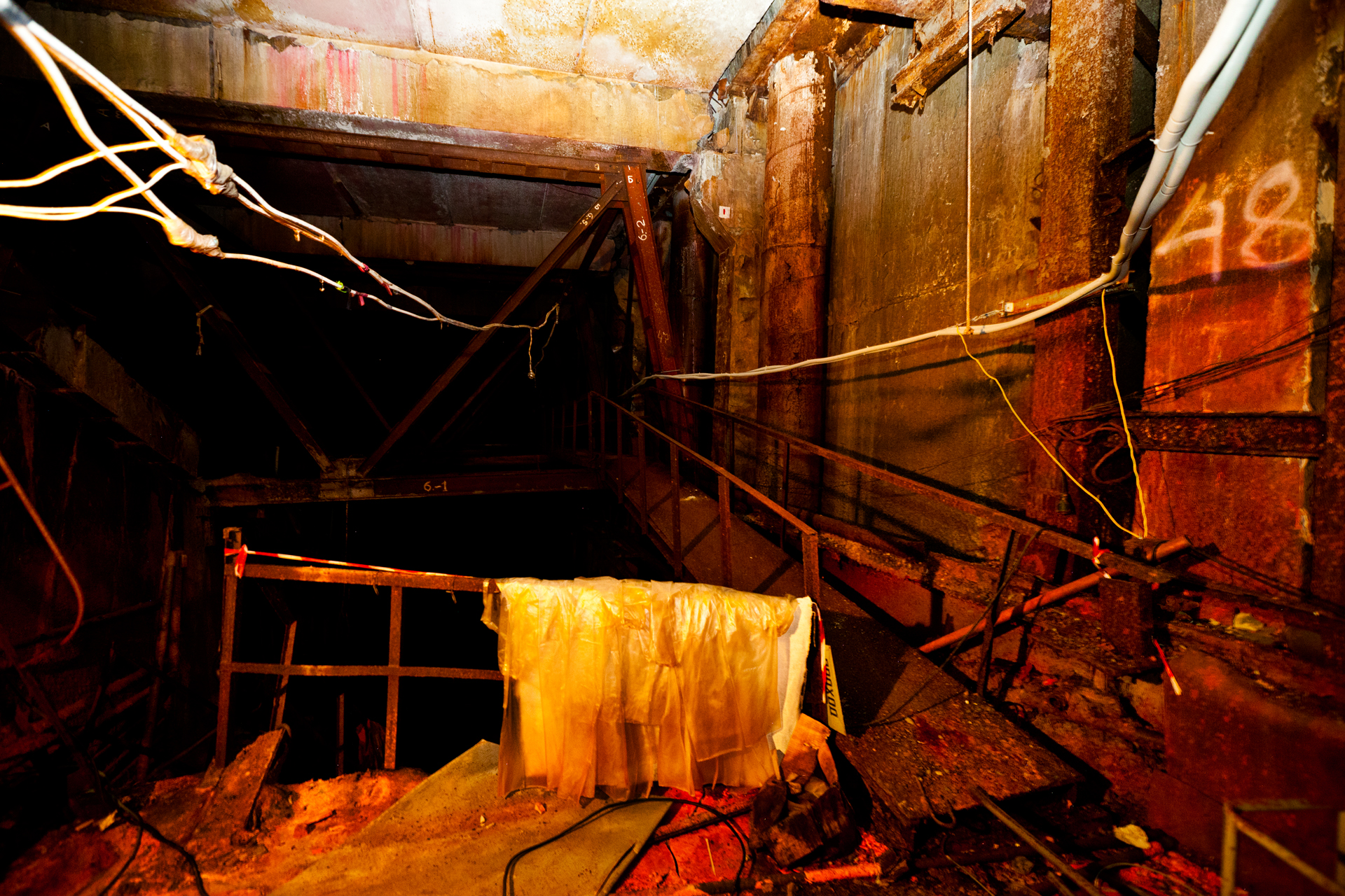Inside unit #4, dimly lit tunnels lead to eerie rooms strewn with wires, pieces of shredded metal and other debris covered with contaminated dust.  Chernobyl Nuclear Power Plant, Ukraine