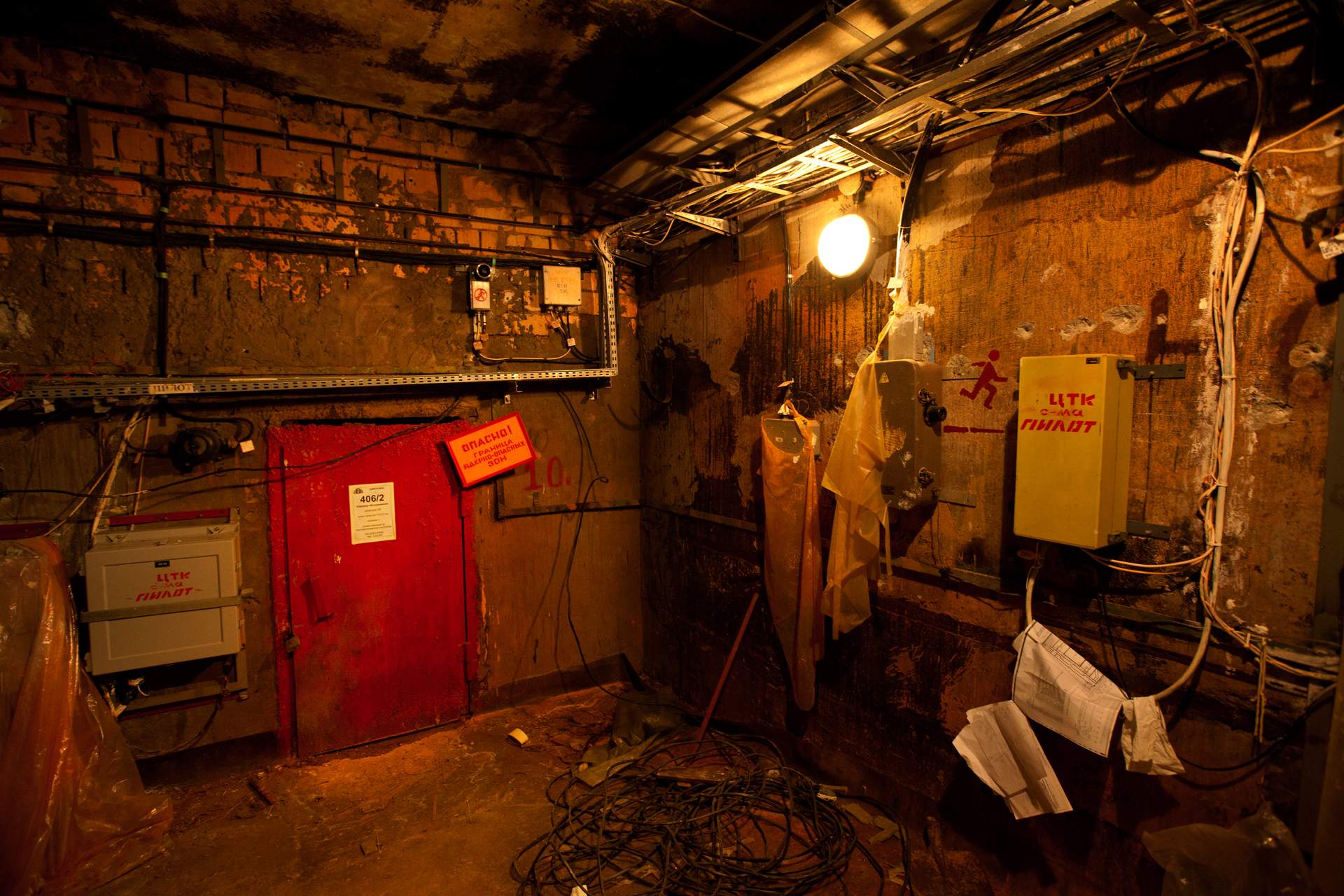 Painted in bright red, a heavy metal door protects the under-reactor department, an area with life-threatening contamination.  Chernobyl Nuclear Power Plant, Ukraine
