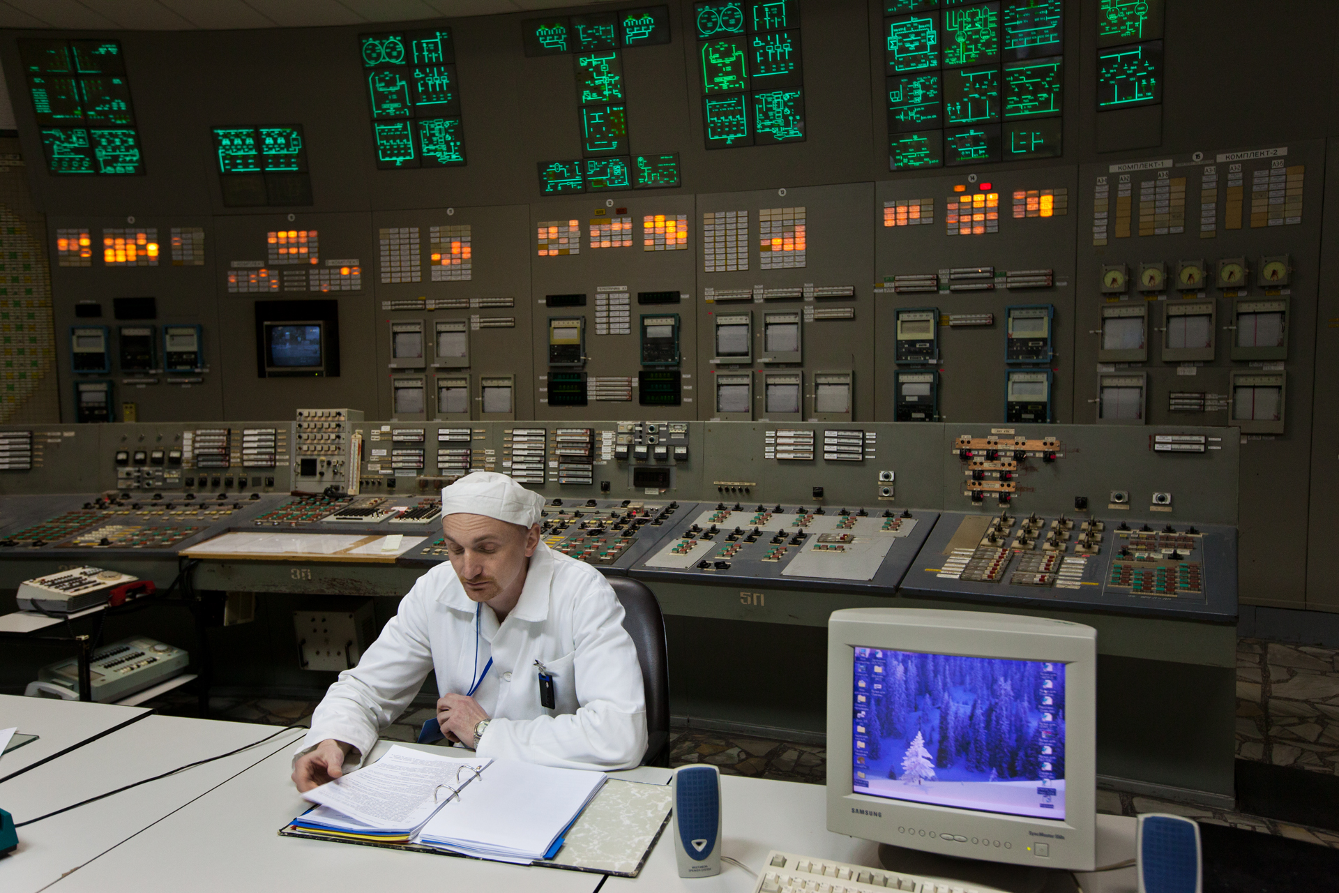 An engineer maintains the safety systems in the control room of reactor #3, identical to the one of reactor #4 where the fatal mistake occurred in 1986.  Chernobyl Nuclear Power Plant, Ukraine