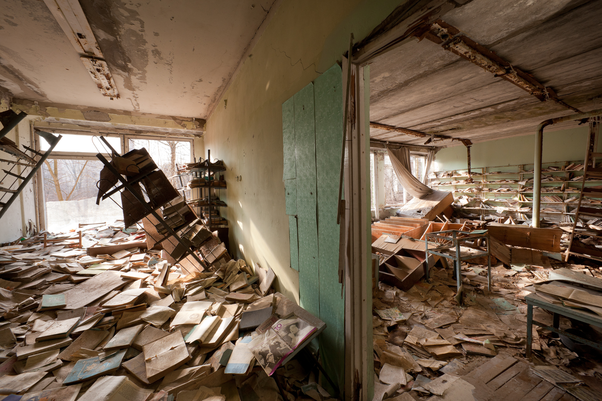 Books rot and paint peels in a school library.  Pripyat, Ukraine