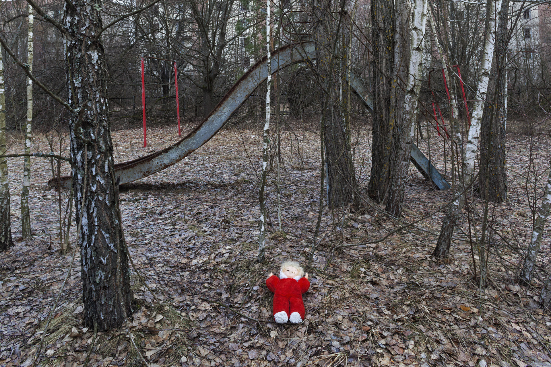The abandoned, lonely doll, neatly arranged, has become a standard tourist motif and an obvious indication that visitors were here.  Pripyat, Ukraine