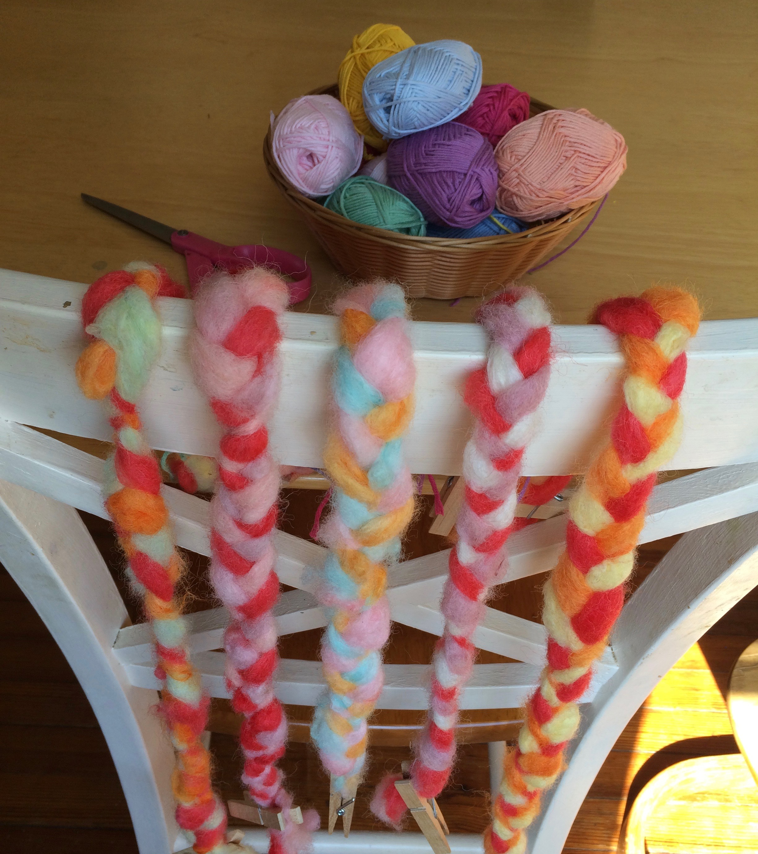 Braided fleece that has been washed, picked, carded, and dyed all by hand