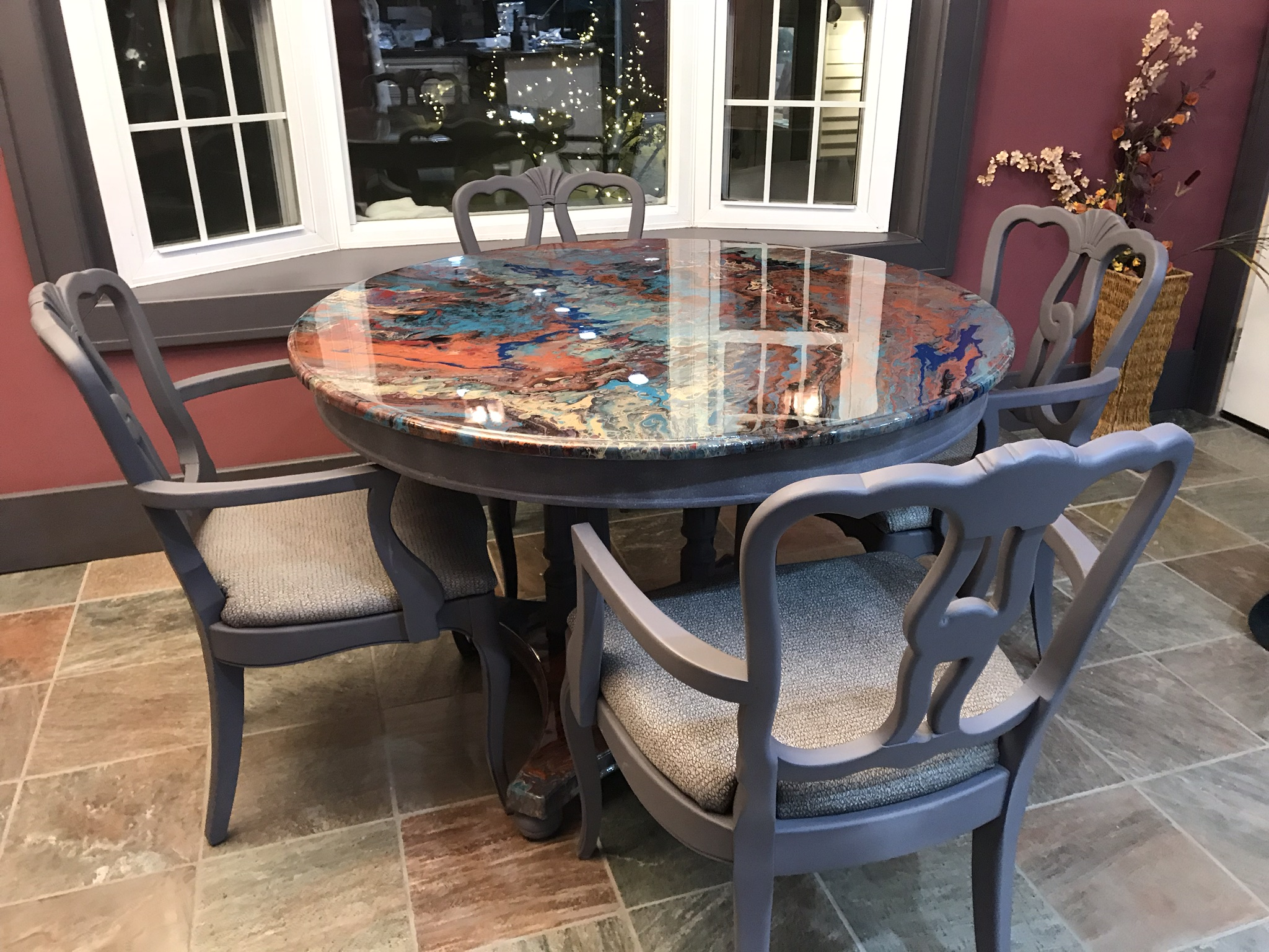 "Dining Table & Chairs  >Table top is is painted with an acrylic pour and sealed with an epoxy resin.  > Chairs are upholstered with a ""wipeable"" fabric and arms were handcrafted and added to chairs.  >Table and chars are solid wood."