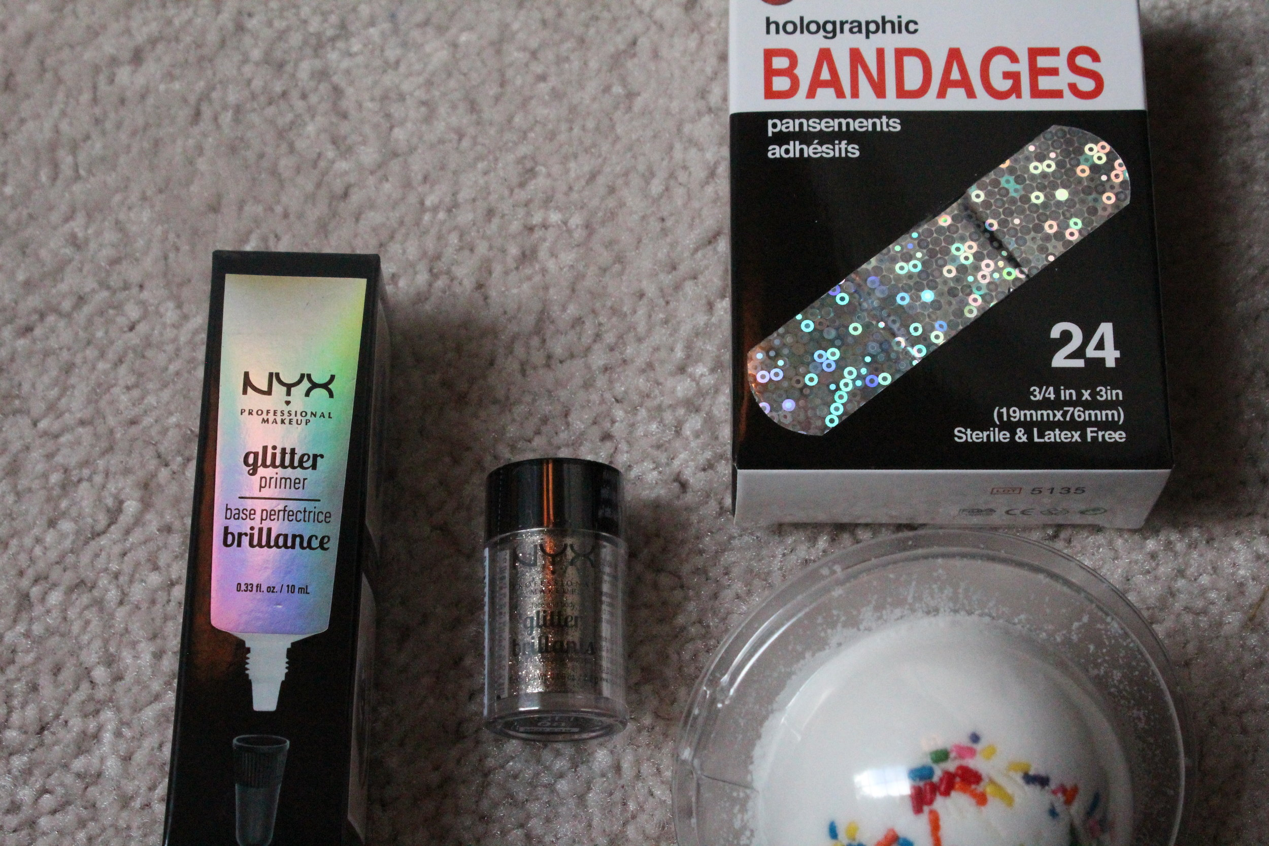 Here we've got some ESSENTIAL makeup and overall self care items. Glitter OBVIOUSLY. And some psychedelic bandages are always a good idea.