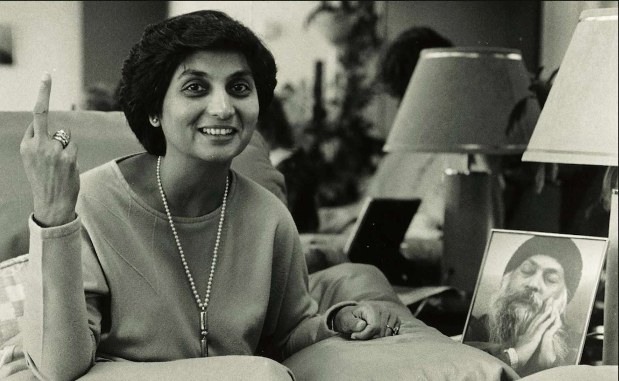 Ma Anand Sheela and a photo of Osho (Bhagwan) Photo: Netflix