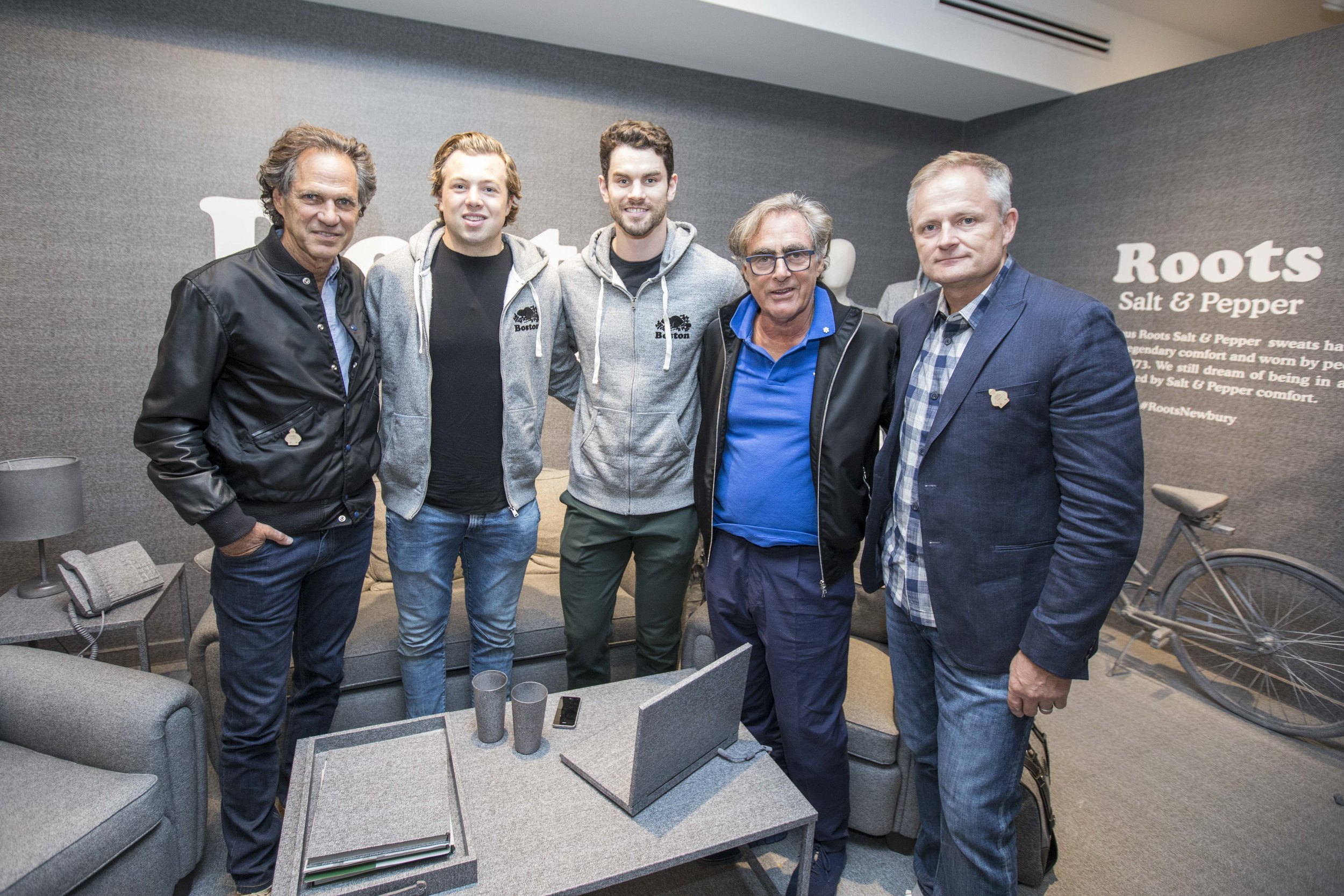 Don Green, Charlie McAvoy, Adam McQuaid, Michael Budman, and Roots CEO, Jim Gabel.