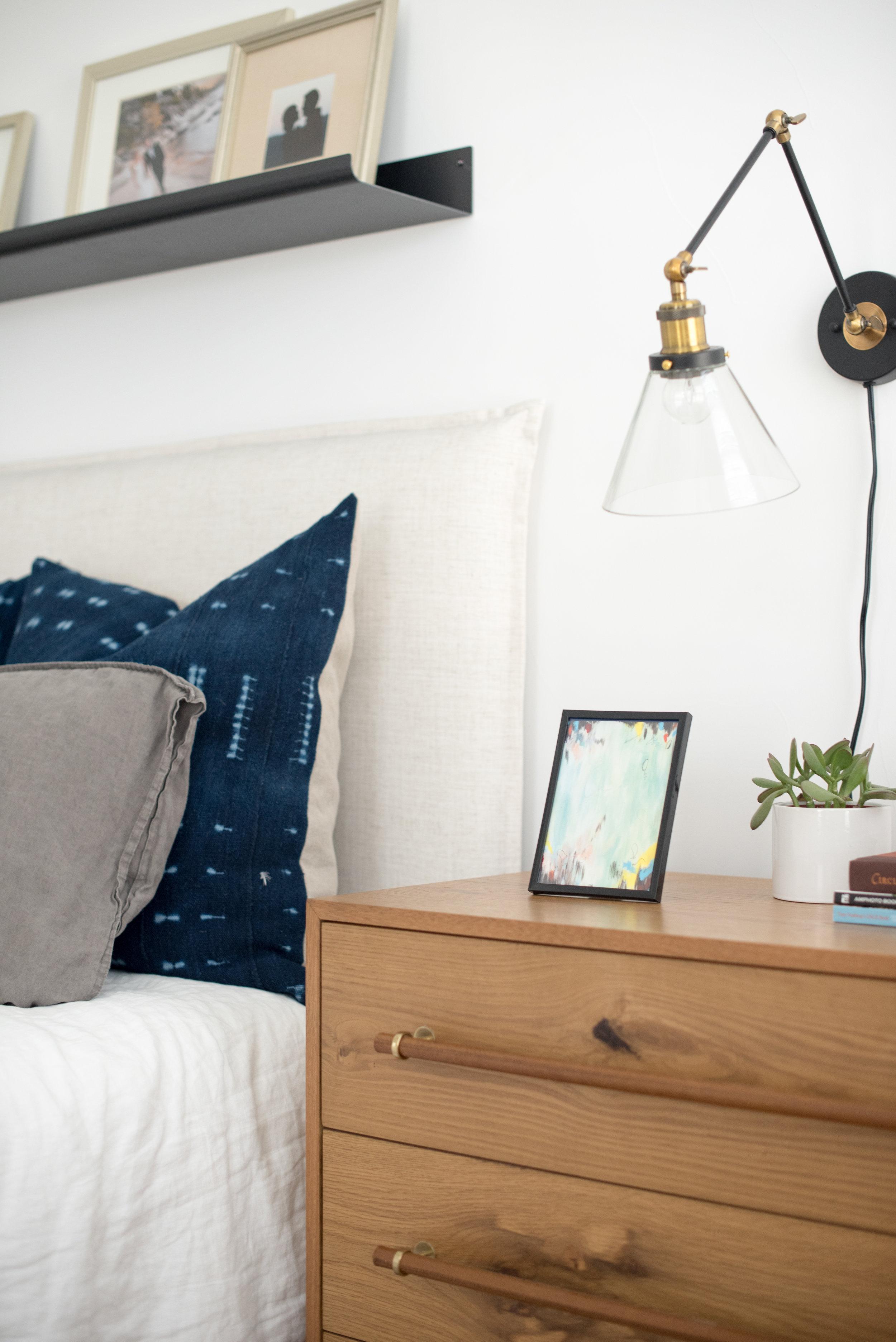 Sleek black frame styling a bedside table