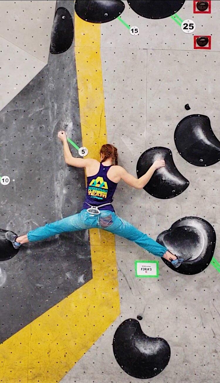 Aubrey climbing at Regionals.