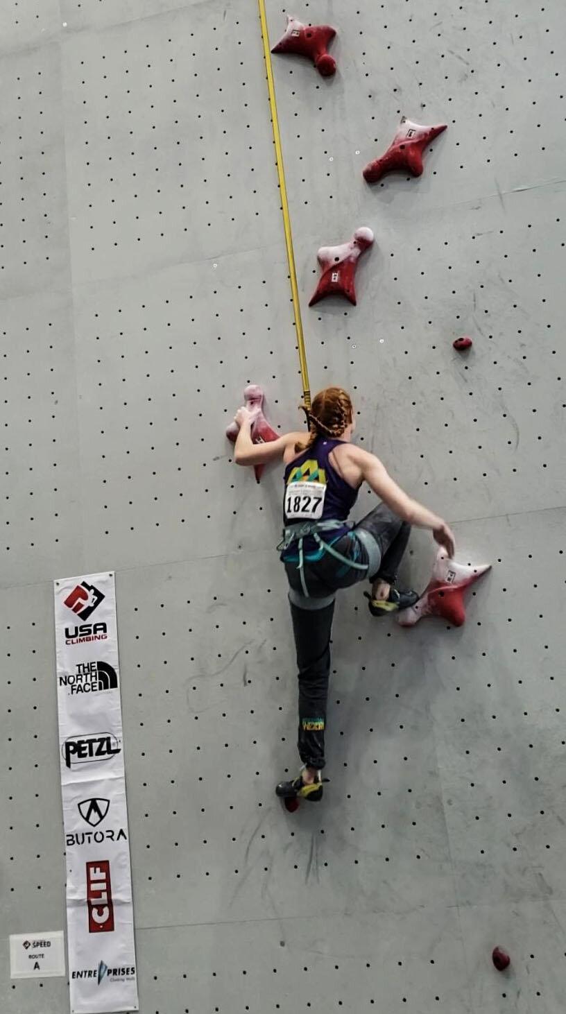 Aubrey speed climbing at Nationals.